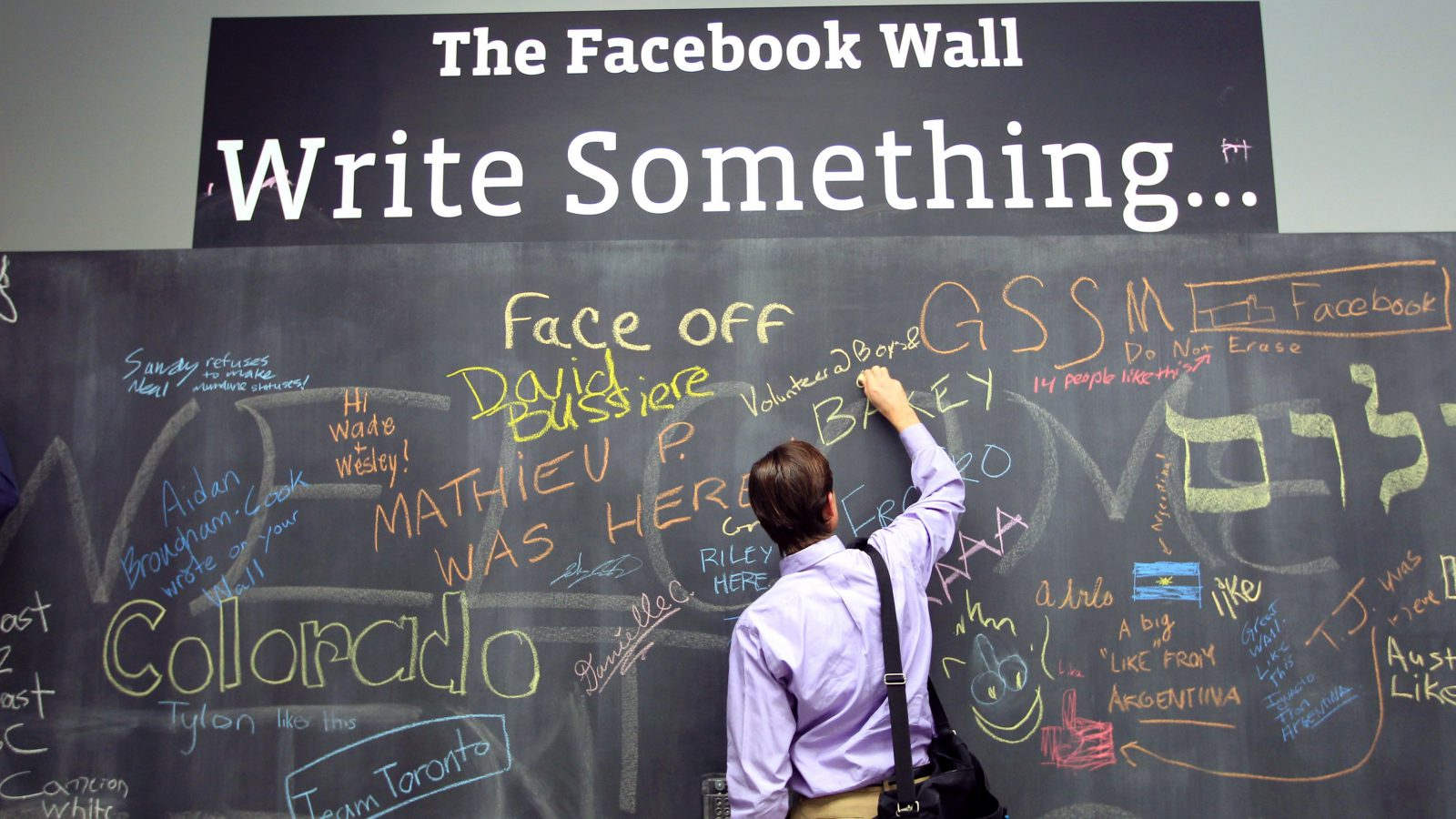 An employee writes a note on the message board at the new headquarters of Facebook in Menlo Park, California January 11, 2012. The 57-acre campus, which formerly housed Sun Microsystems, features open work spaces for nearly 2,000 employees on the one million square foot campus, with room for expansion. Picture taken January 11, 2012. REUTERS/Robert Galbraith  (UNITED STATES - Tags: SCIENCE TECHNOLOGY MEDIA TPX IMAGES OF THE DAY) - RTR2W75S