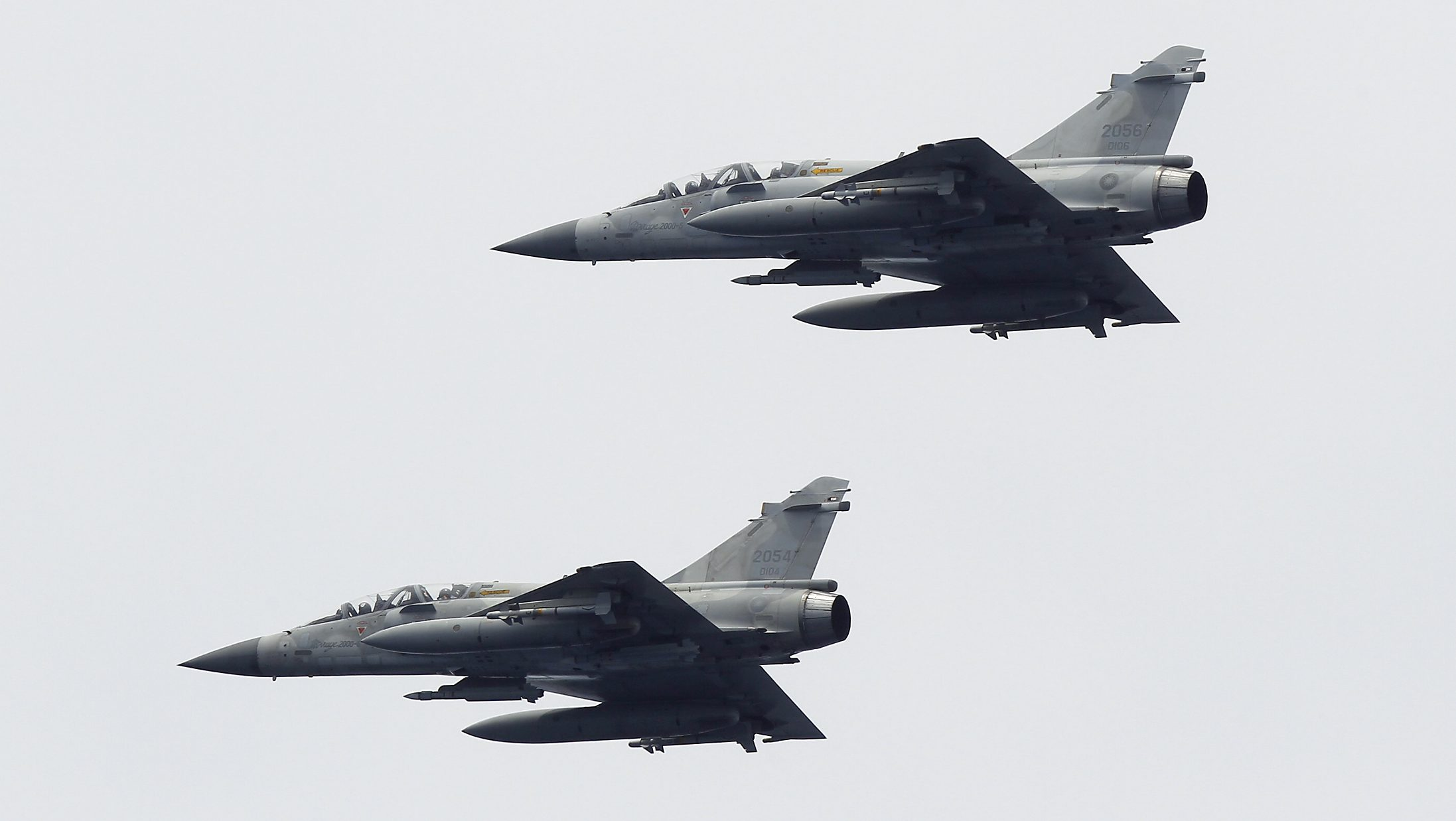 Taiwan Air Force Mirage-2000 fighter jets take part in a joint military drill outside a navy base in Kaohsiung port