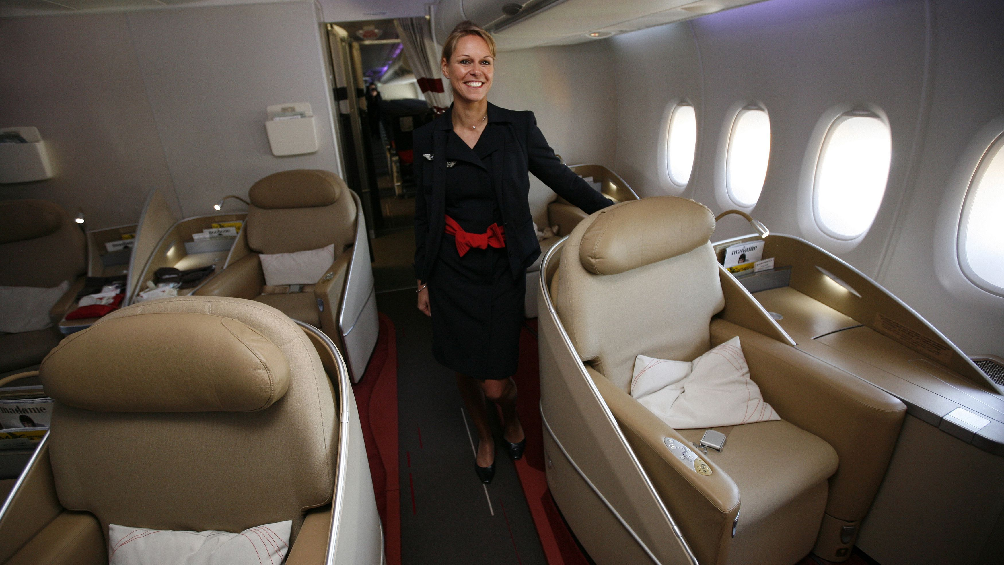 An Air France KLM flight attendant poses at the first class cabin of new Airbus A380 aircraft during a hand-over ceremony at the manufacturer's site in Finkenwerder near Hamburg October 30, 2009. Air France has taken delivery of its first Airbus A380 on Friday as the first European airline to fly the double-deck aircraft on scheduled services. REUTERS/Christian Charisius