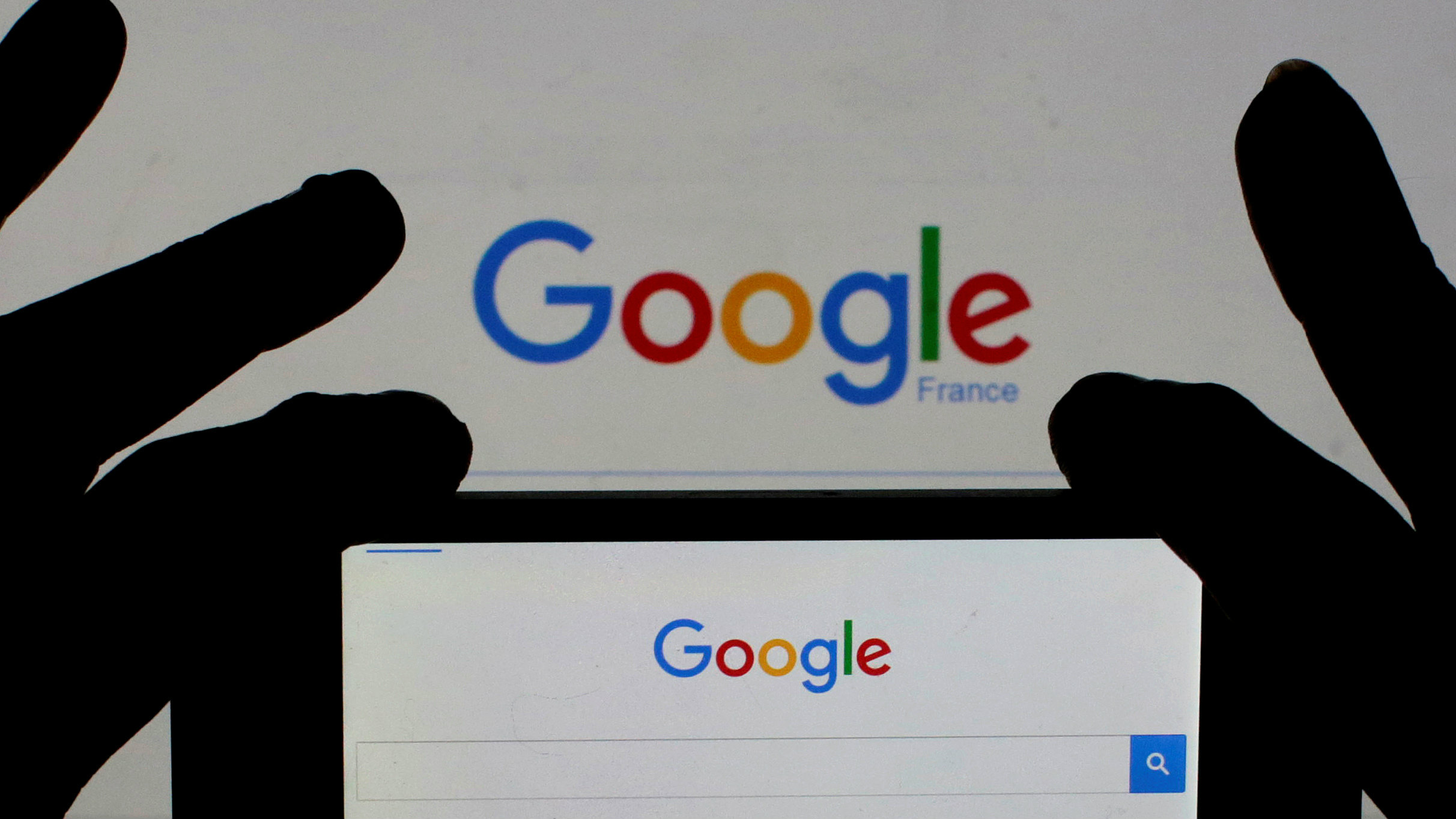 A woman holds her smart phone which displays the Google home page, in this picture illustration taken February 24, 2016. REUTERS/Eric Gaillard/Illustration/File Photo