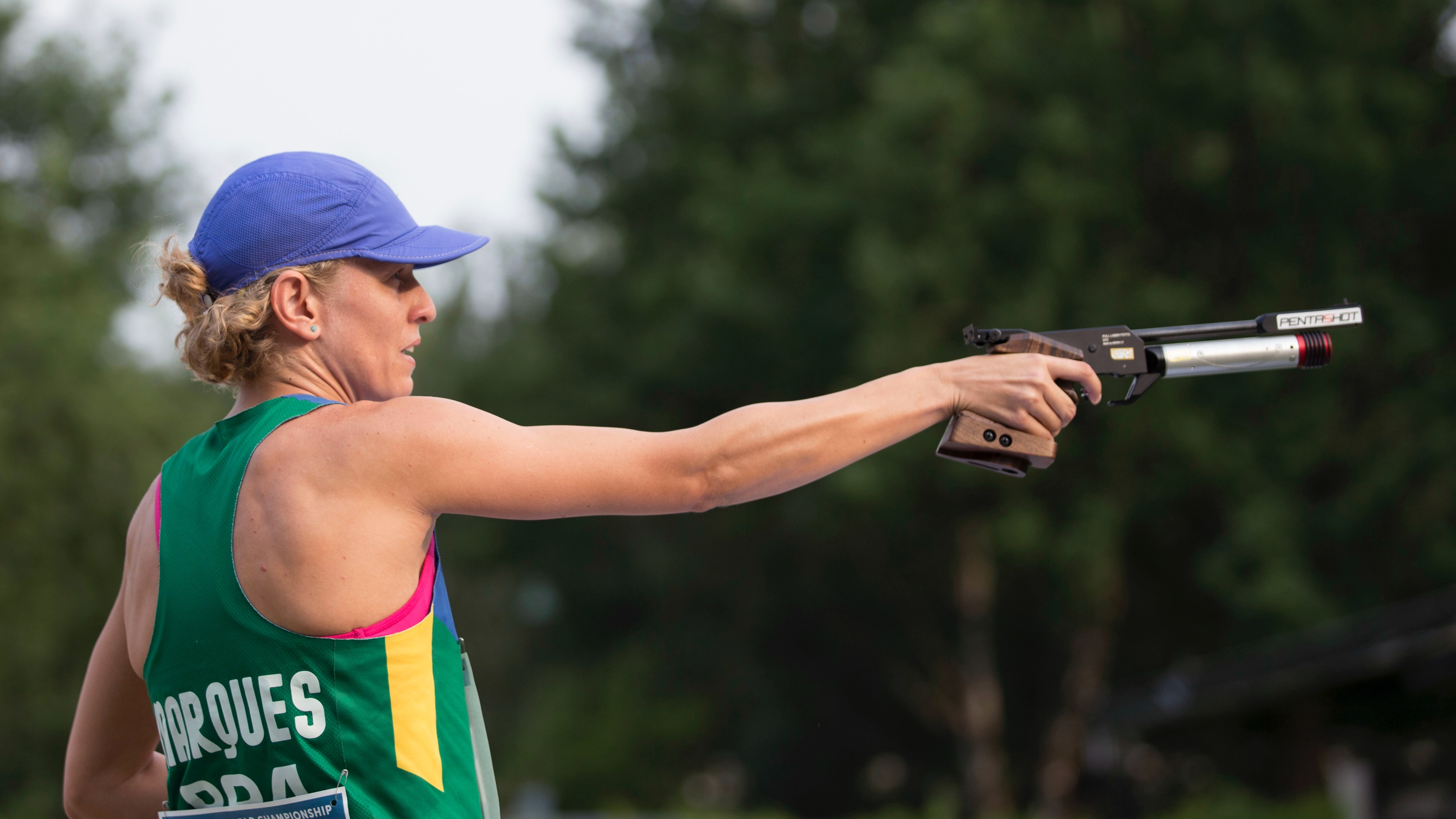 Yane Marques of Brazil shoots during the women's combined competition of the Modern Pentathlon World Championships in Berlin, Germany, Saturday, July 4, 2015. (AP Photo/Axel Schmidt)