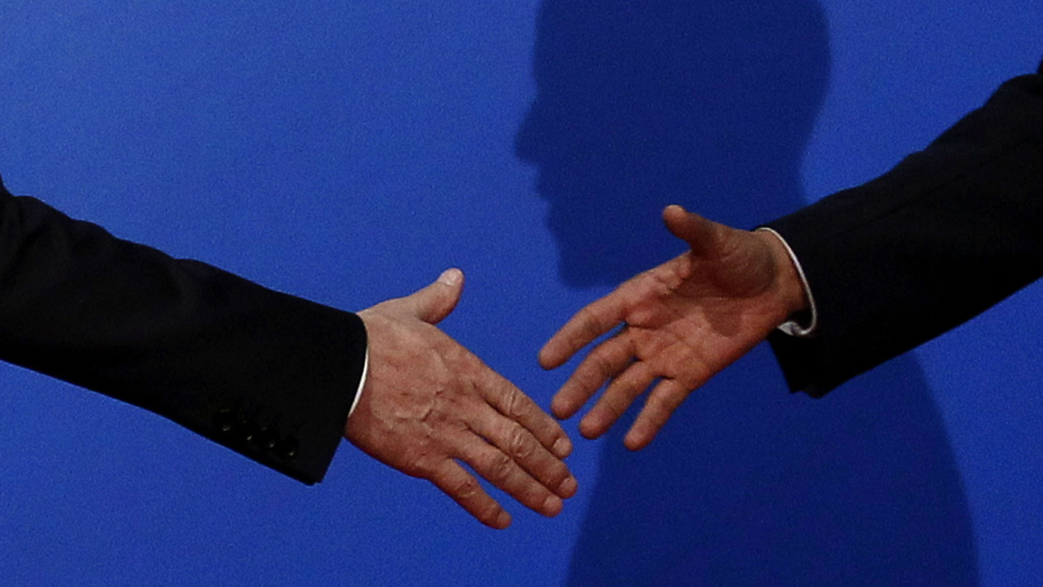 "U.S. President Barack Obama casts a shadow as he reaches out to shake hands with South Korea's President Lee Myung-bak at the official arrival for the G20 Summit working dinner at the National Museum in Seoul, November 11, 2010. This photo won an Award of Excellence in the Presidential category in the White House News Photographer's Association (WHNPA) ""Eyes of History 2011"" contest and was also part of Jim Young's entries in the Porfolio and Poltical Portfolio categories which also received awards in the contest."
