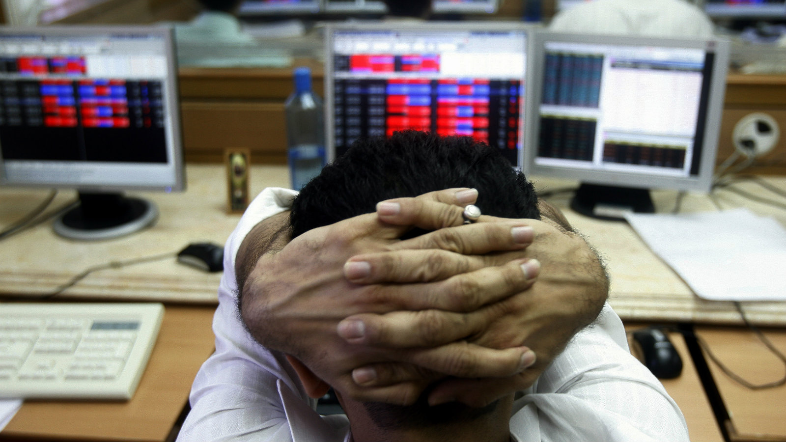 A broker reacts while trading at a stock brokerage firm in Mumbai October 8, 2008.