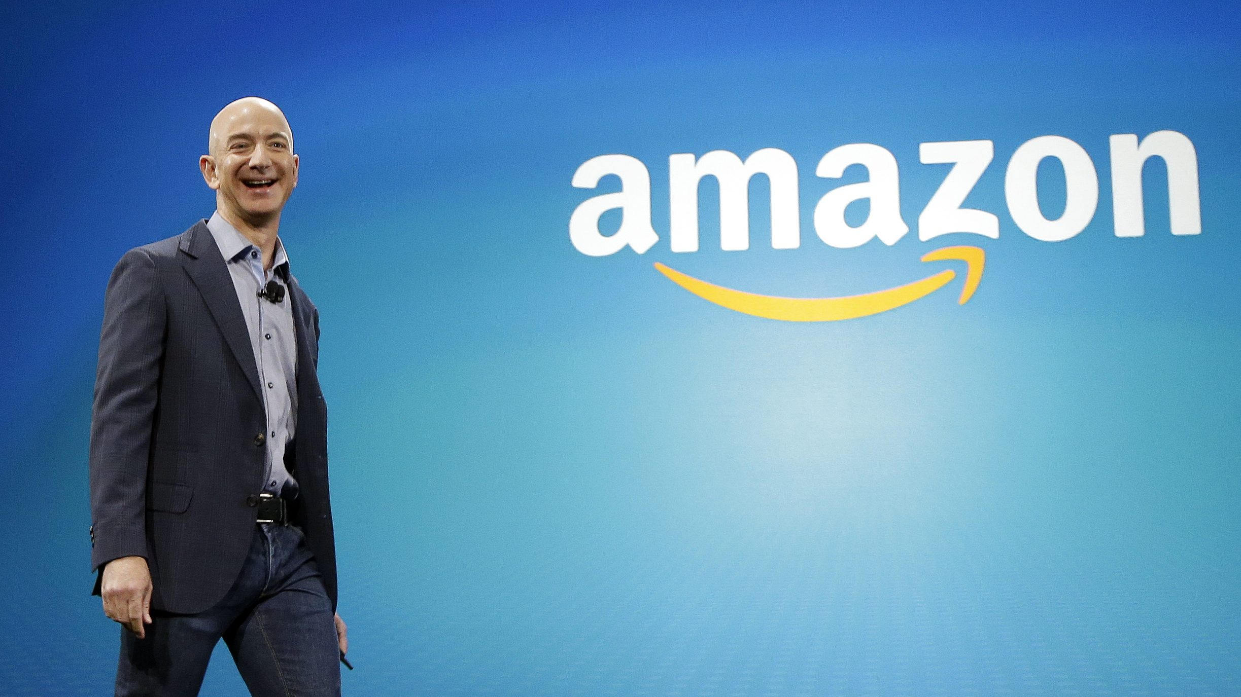 FILE - In this June 16, 2014, file photo, Amazon CEO Jeff Bezos walks onstage for the launch of the new Amazon Fire Phone, in Seattle. Bezos offered a glimpse of his vision for the future during an interview on May 31, 2016, at the Code Conference in Rancho Palos Verdes, Calif.