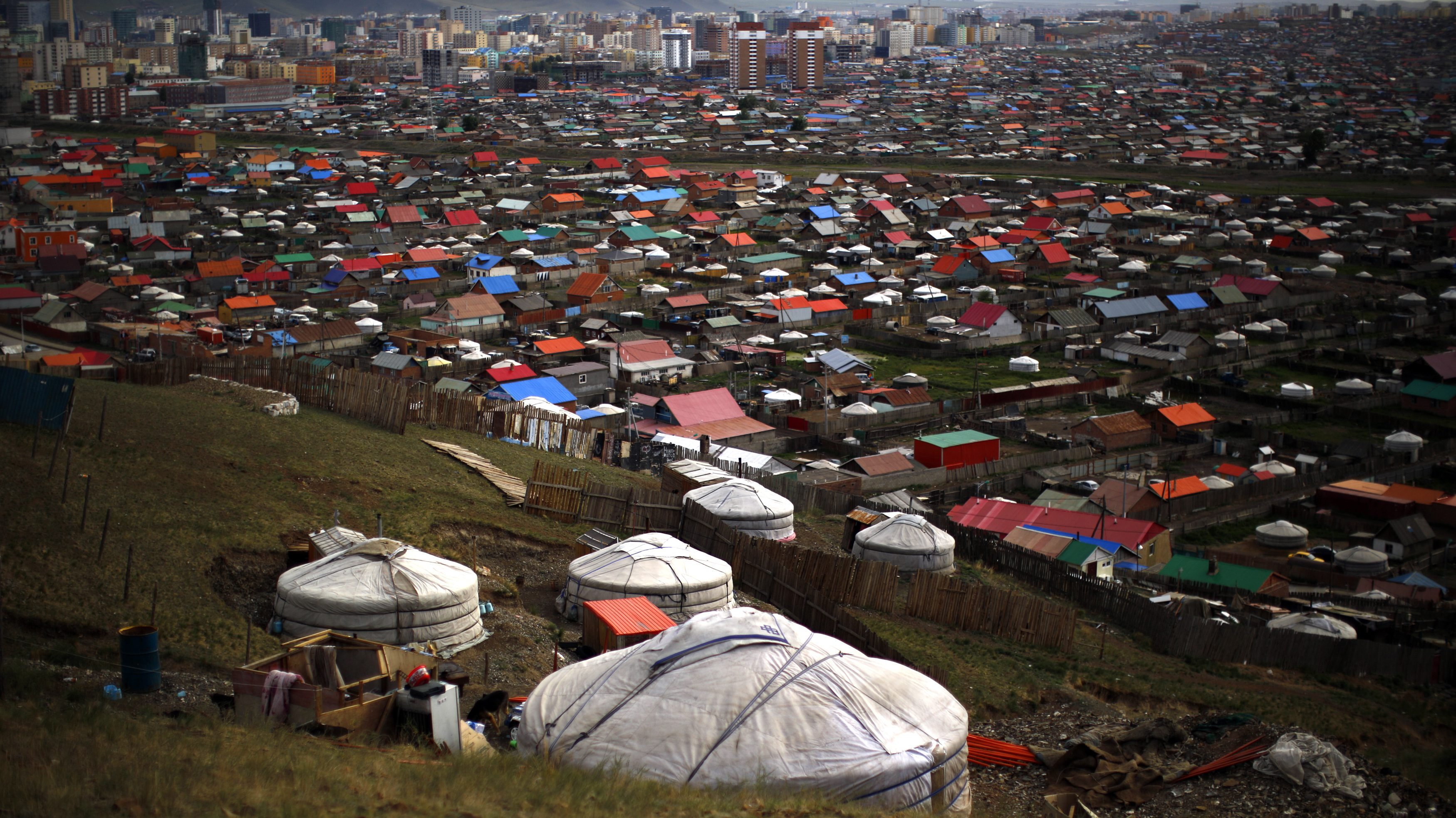 Gers, traditional Mongolian tents, are seen on a hill in an area known as a ger district in Ulan Bator June 28, 2013. Approximately 60 percent of the population of Ulan Bator live in settlements known as ger districts and in many cases residents have limited access to basic services such as water and sanitation. According to a 2010 National Population Center census, every year between thirty and forty thousand people migrate from the countryside to the capital Ulan Bator. Ger districts in the city have been expanding rapidly in recent years. Mongolia is the world's least densely populated country, with 2.8 million people spread across an area around three times the size of France. Picture taken June 28, 2013.
