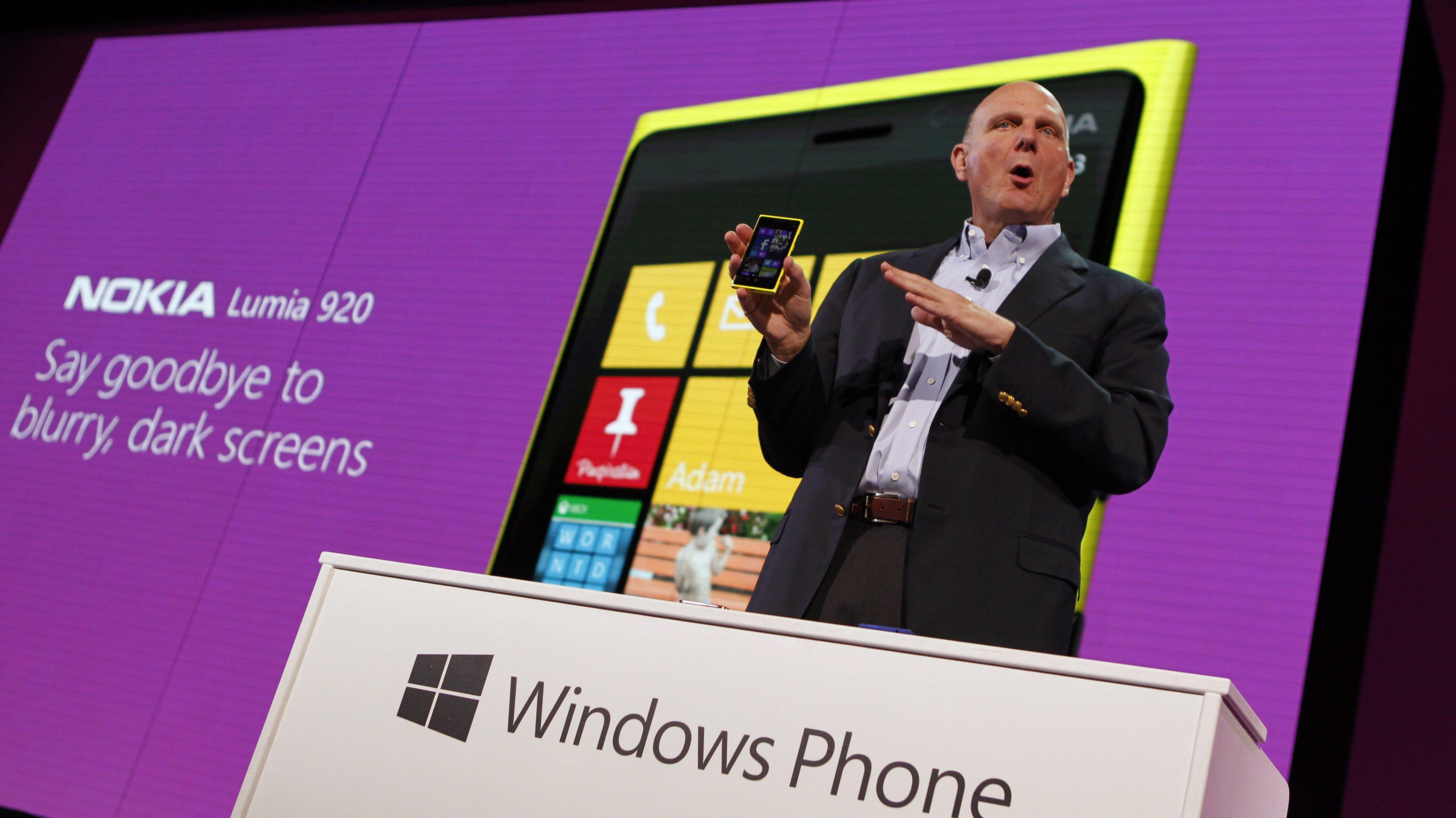 Microsoft CEO Ballmer displays a Nokia Lumia 920 featuring Windows Phone 8 during an event in San Francisco