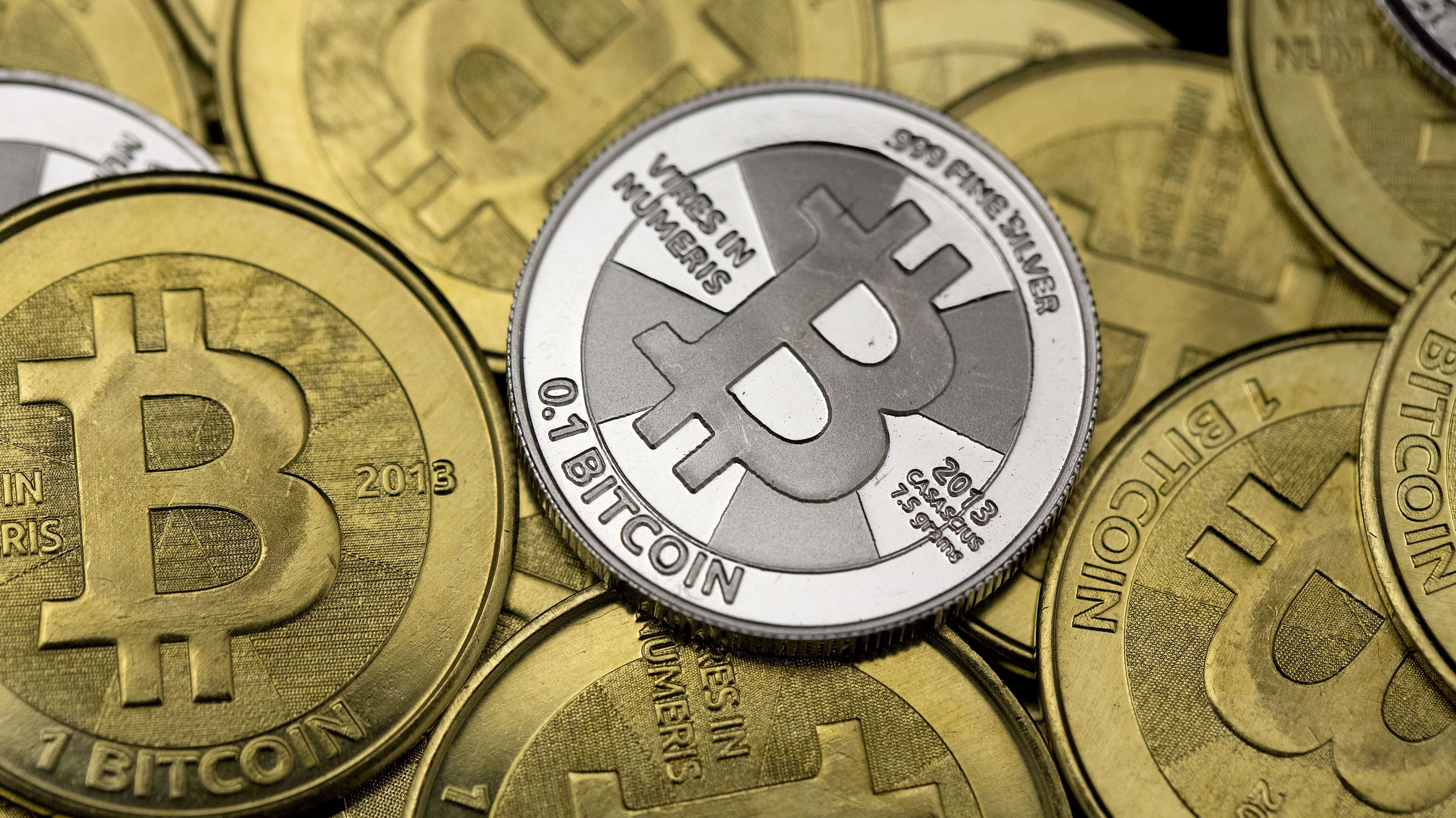 Bitcoin is being taken up in zimbabwe nigeria south africa and some of bitcoin enthusiast mike caldwells coins are pictured at his office in this photo illustration ccuart Images