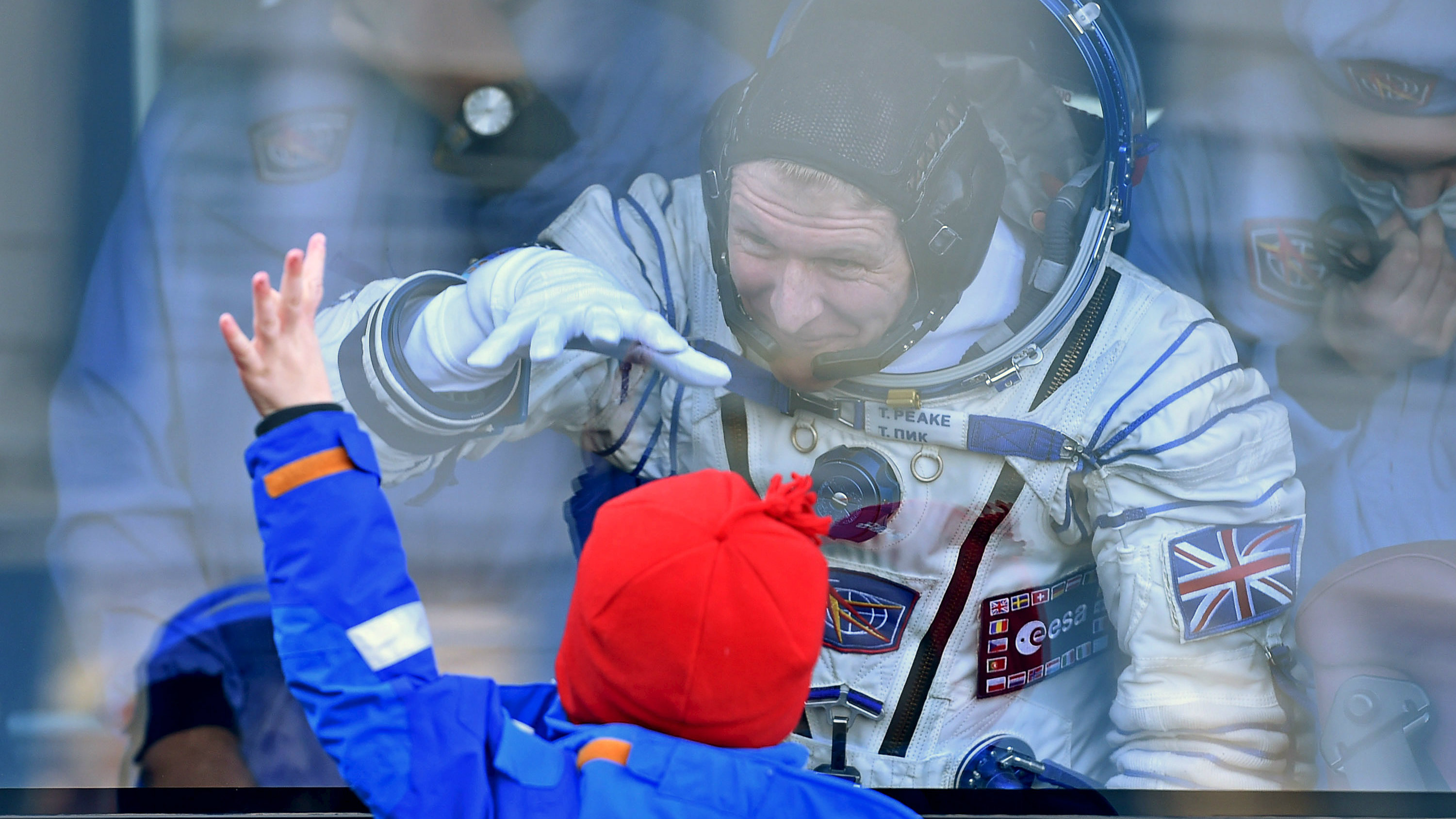 Member of the International Space Station expedition 46/47, British ESA astronaut Timothy Peake chats with his children during a sending-off ceremony at the Baikonur cosmodrome in Kazakhstan, 15 December 2015, before travelling on board the Soyuz TMA-19M spacecraft to the International Space Station (ISS). REUTERS/Kirill Kudryavtsev/Pool TPX IMAGES OF THE DAY