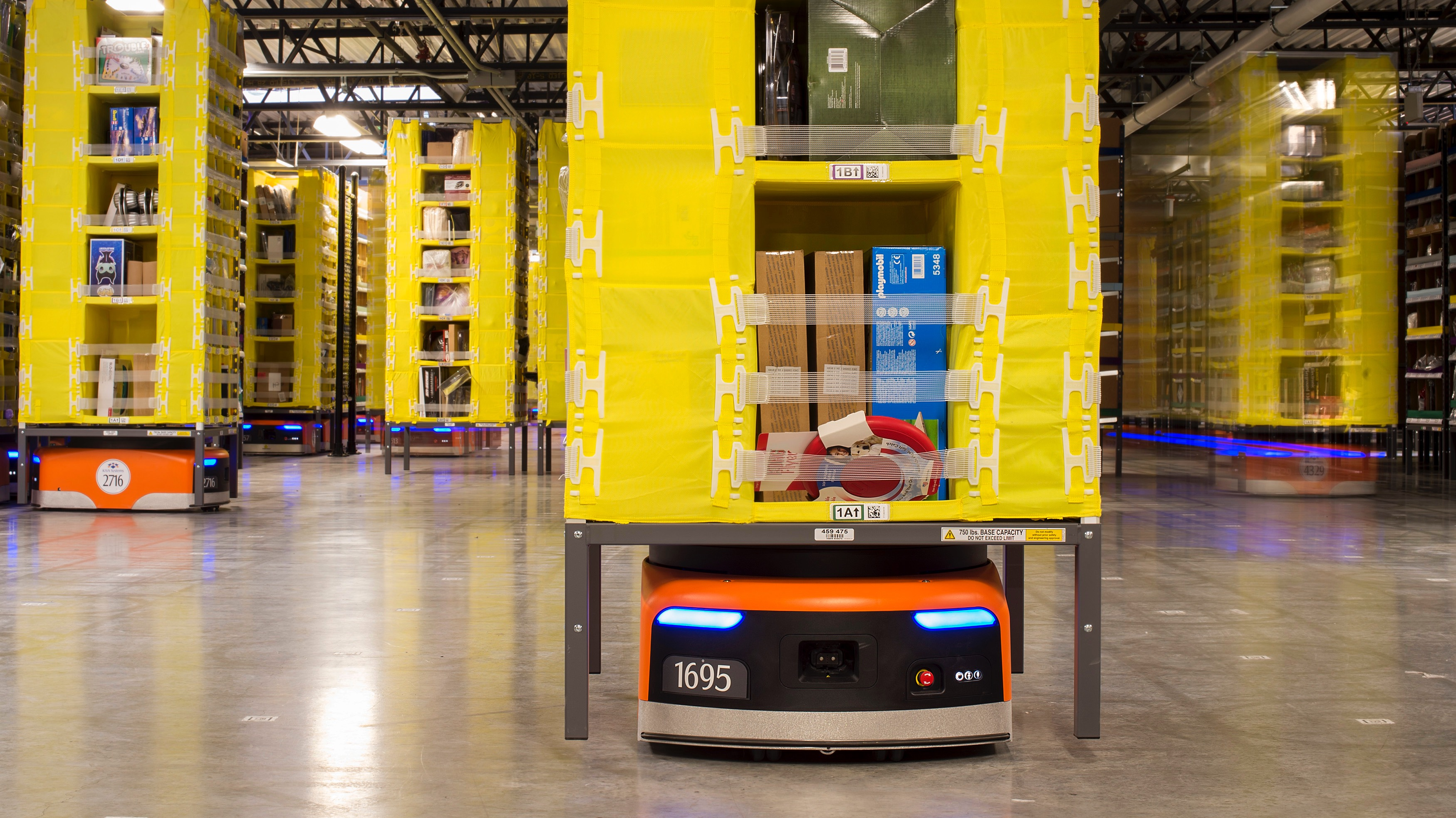 Kiva robots move inventory at an Amazon fulfilment center in Tracy, California December 1, 2014. Amazon.com Inc has installed more than 15,000 robots across 10 U.S. warehouses, a move that promises to cut operating costs by one-fifth and get packages out the door more quickly in the run-up to Christmas.   REUTERS/Noah Berger  (UNITED STATES - Tags: SCIENCE TECHNOLOGY BUSINESS) - RTR4GBF0