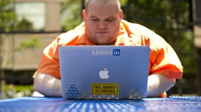 Tuesday, May 7, 2013, file photo, Greg Leffler, a site reliability engineer at LinkedIn, works outside his company's Mountain View, Calif., headquarters. LinkedIn Corp. reports quarterly financial results after the market closes on Thursday, Aug. 1, 2013. (AP Photo/Noah Berger, File)