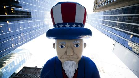 In this Nov. 28, 2013, file photo, a giant Uncle Sam balloon is marched down Sixth Avenue during the 87th Annual Macy's Thanksgiving Day Parade in New York. Helium makes the huge balloons in the parade sail high above the crowd. (AP Photo/John Minchillo)