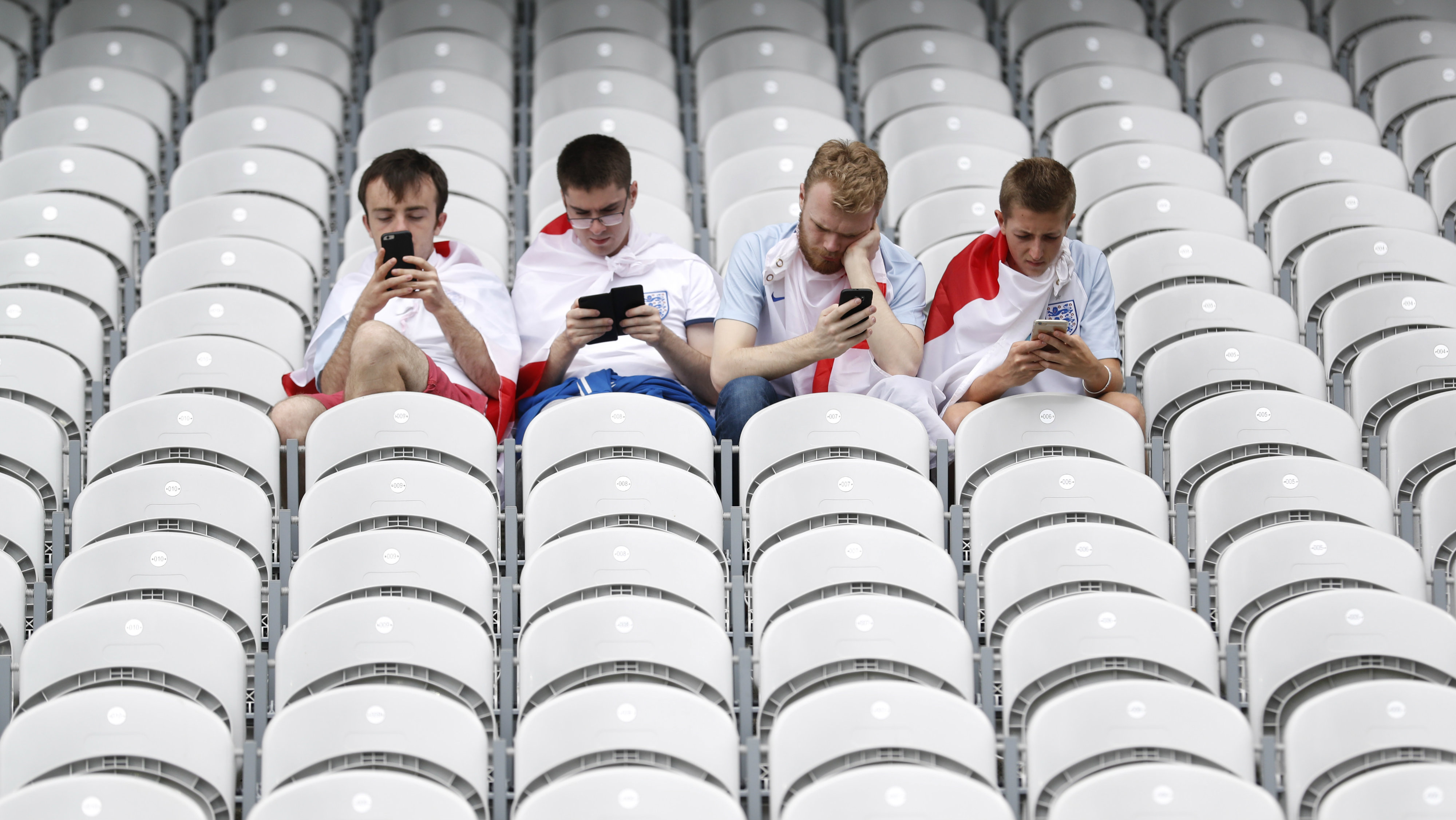 Football Soccer - England v Wales - EURO 2016 - Group B - Stade Bollaert-Delelis, Lens, France - 16/6/16 England fans use their phones before the game REUTERS/Carl Recine Livepic