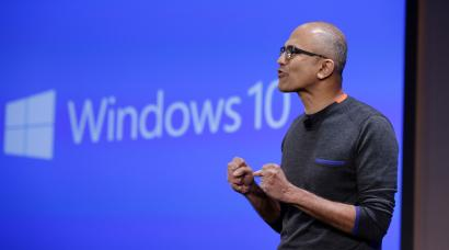 Microsoft CEO Satya Nadella speaks at an event demonstrating new features of Windows 10 at the company's headquarters Wednesday, Jan. 21, 2015, in Redmond, Wash. Executives demonstrated how they said the new Windows is designed to provide a more consistent experience and a common platform for software apps on different devices, from personal computers to tablets, smartphones and even the company's Xbox gaming console. (AP Photo/Elaine Thompson)