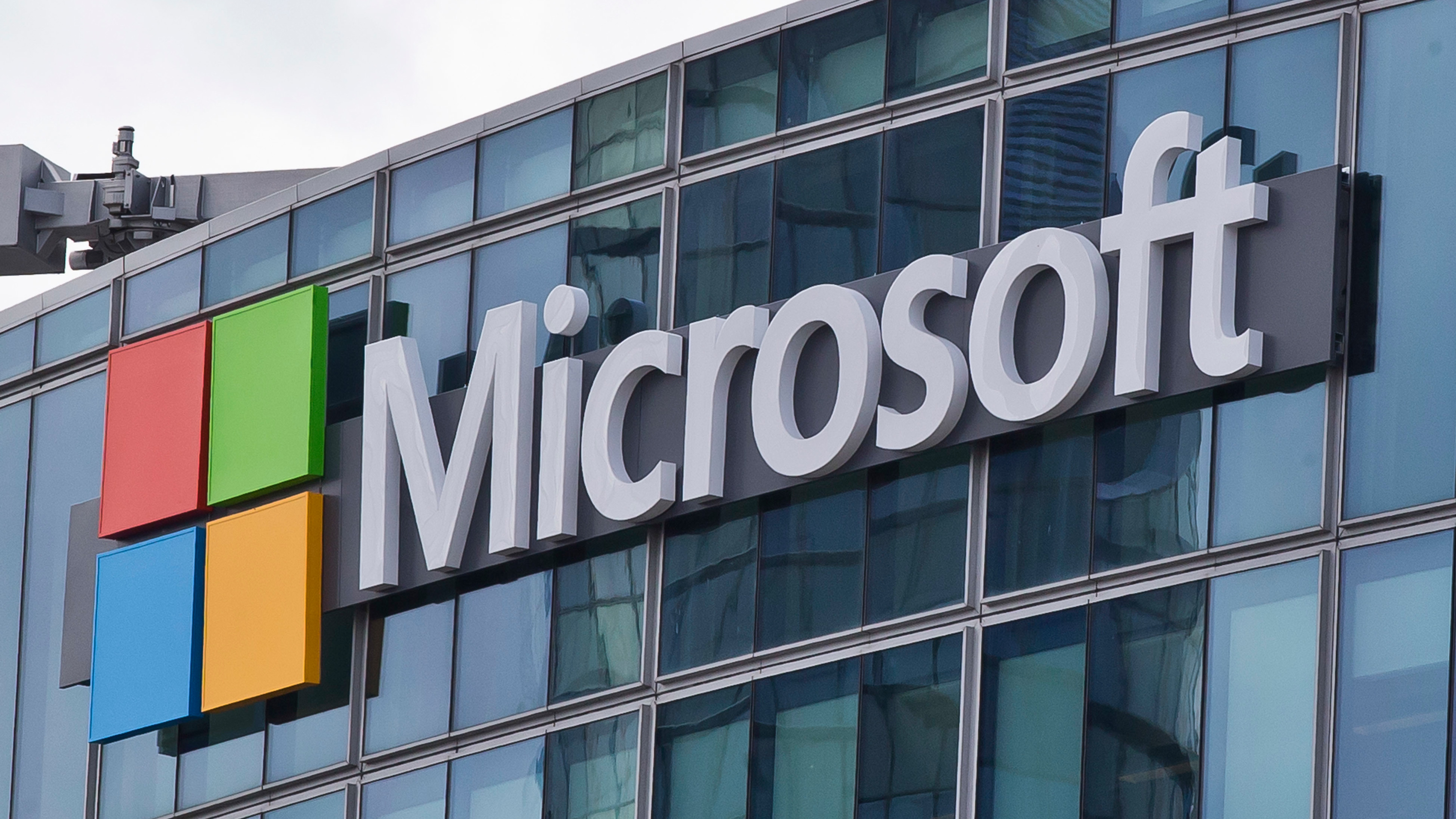 FILE - This Tuesday, April 12, 2016, file photo, shows the Microsoft logo in Issy- les-Moulineaux, outside Paris. Microsoft is joining other tech giants attempting to deliver the Internet to remote parts of the world. But unlike expensive and ambitious plans by Google and Facebook to use satellites, drones and balloons to do so, the software company is making grants to businesses that provide online access, software or related services. (AP Photo/Michel Euler, File)