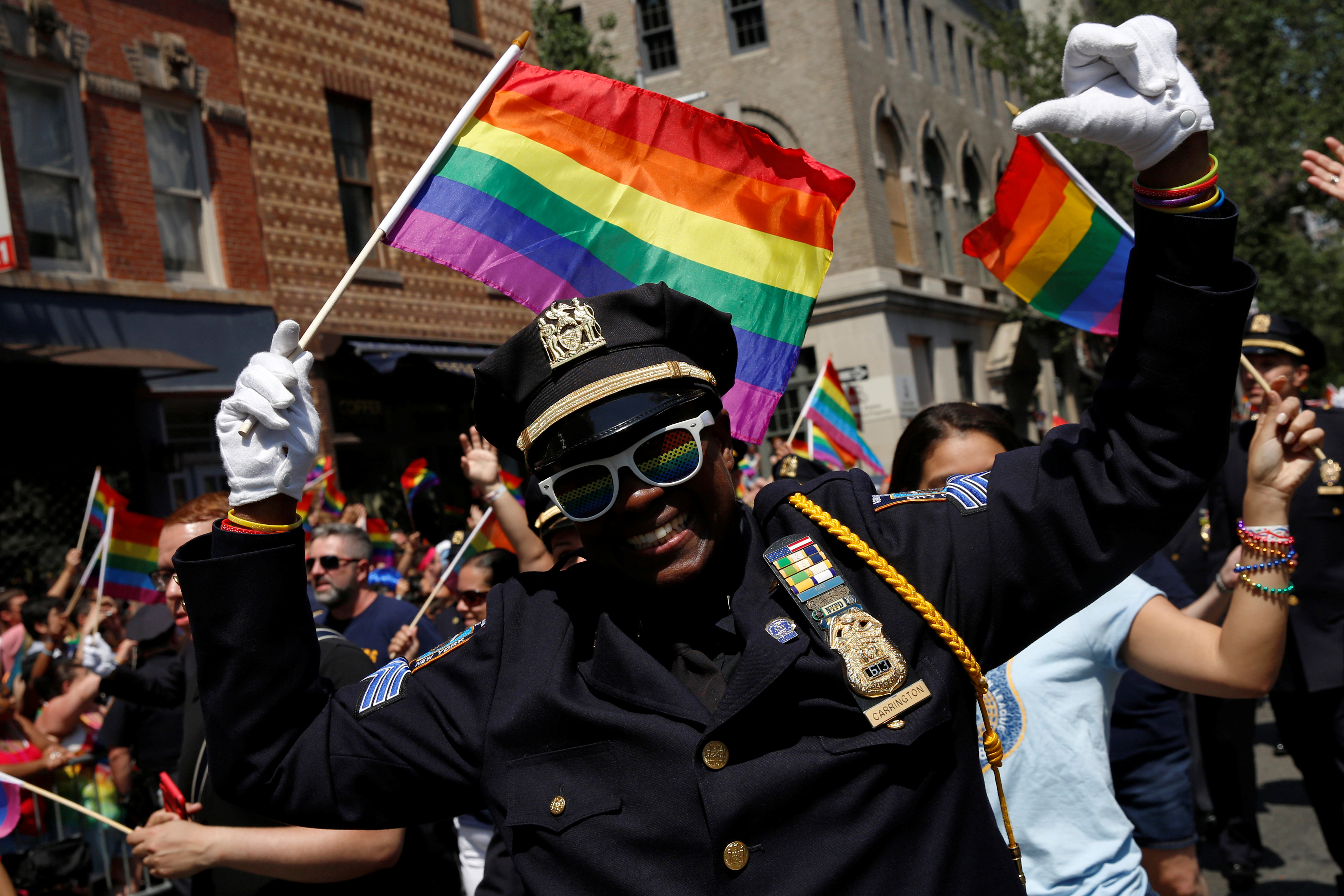 A New York City Police officer (NYPD) marches in the annual NYC Pride parade in New York