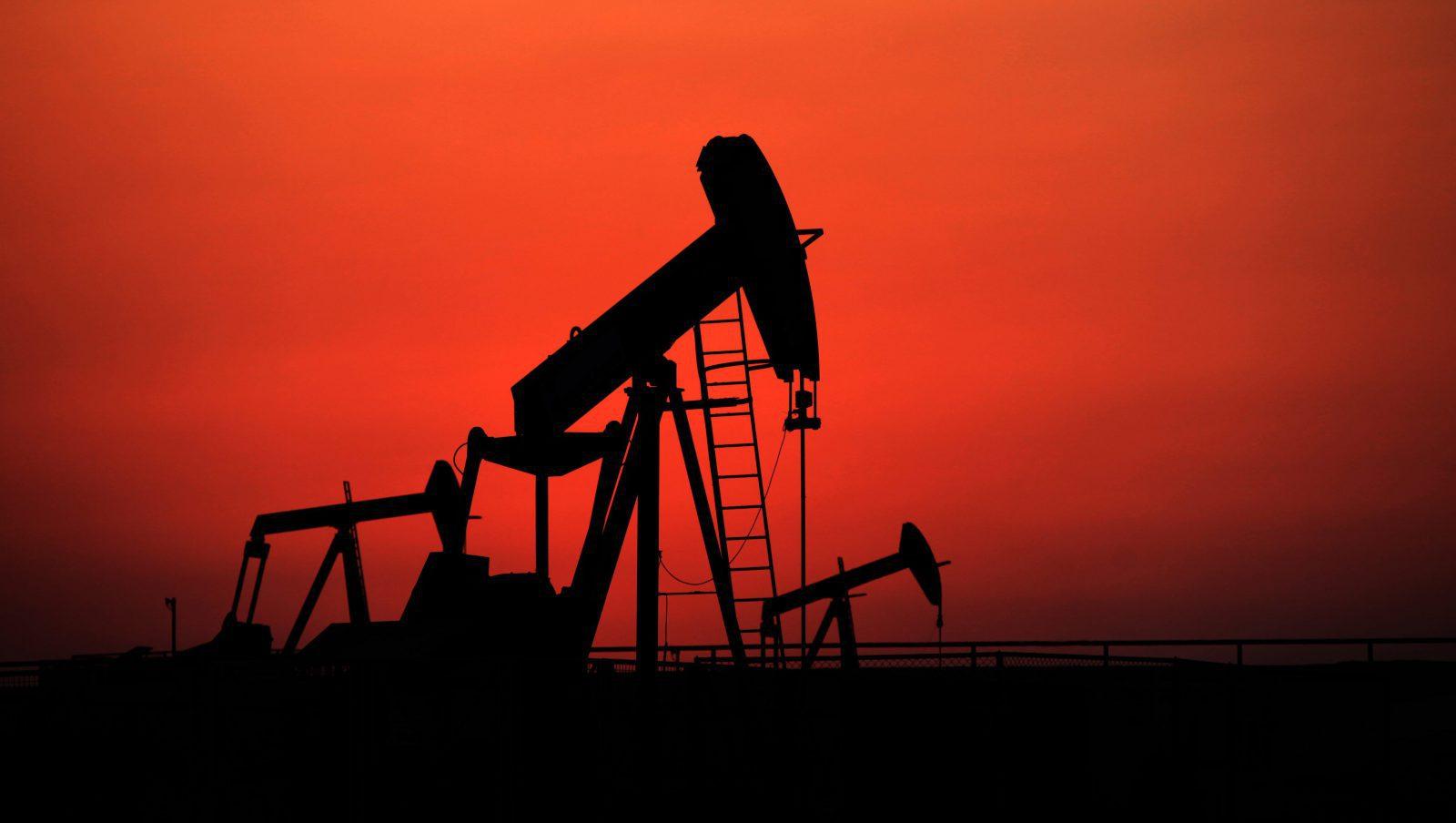 Oil pumps work at sunset on Sept. 11, 2013, in the desert oil fields of Sakhir, Bahrain.