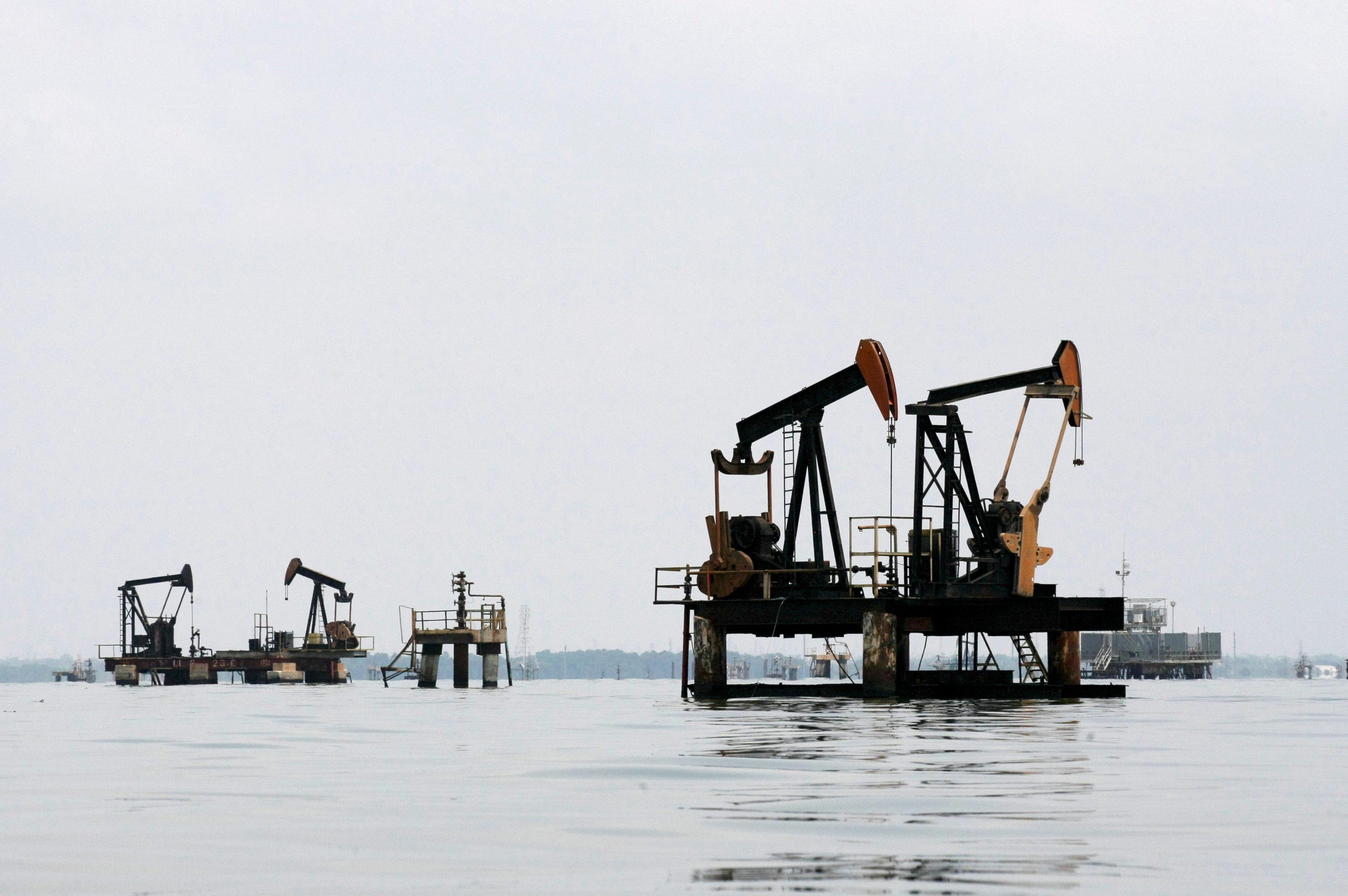 Oil pumps are seen in Lake Maracaibo, in Lagunillas, Ciudad Ojeda, in the state of Zulia, Venezuela, March 20, 2015.