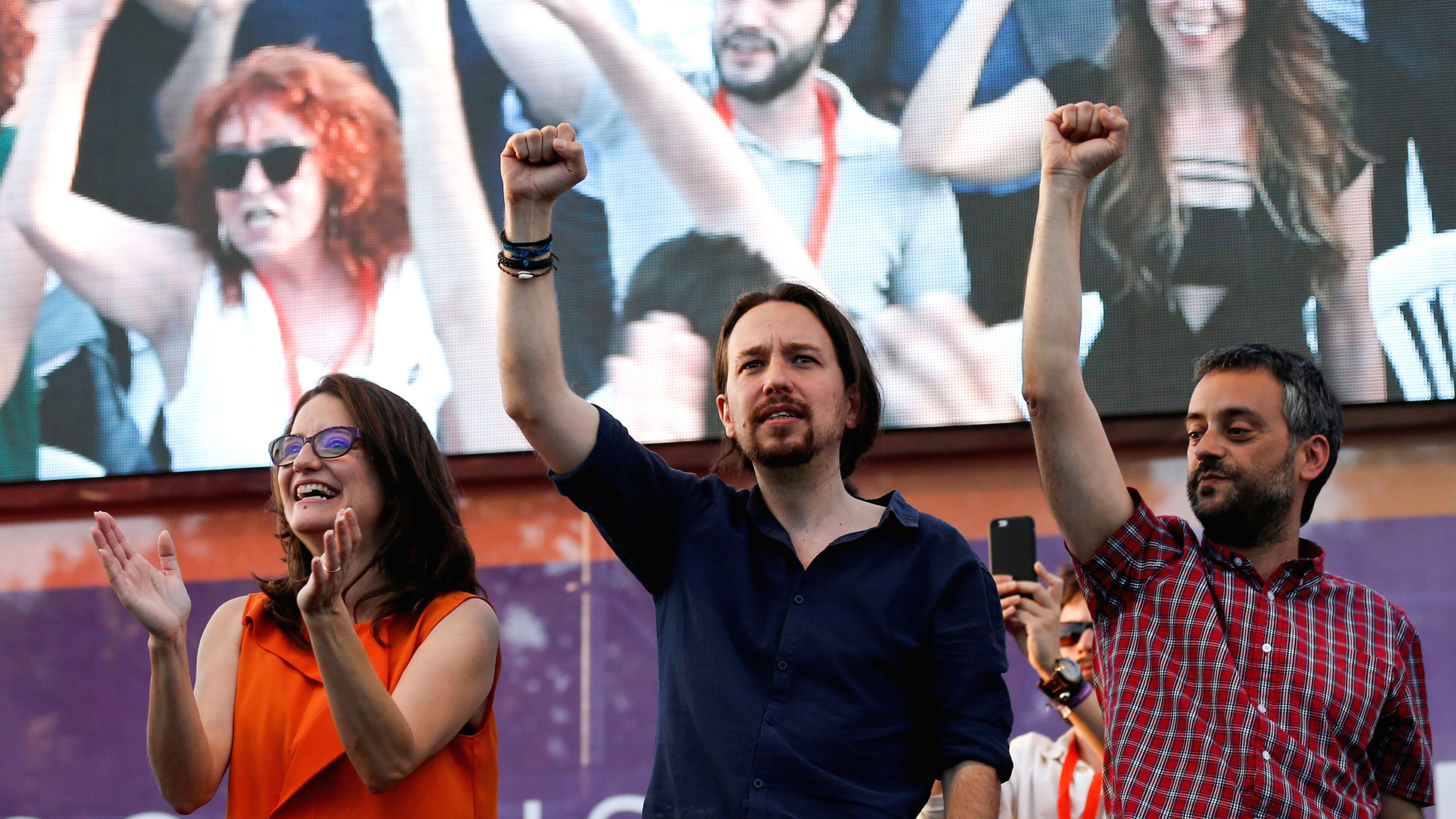 Pablo Iglesias (center) leads a coalition of far-left, anti-establishment political parties that just might clinch a majority in Spain's parliamentary elections on Sunday.