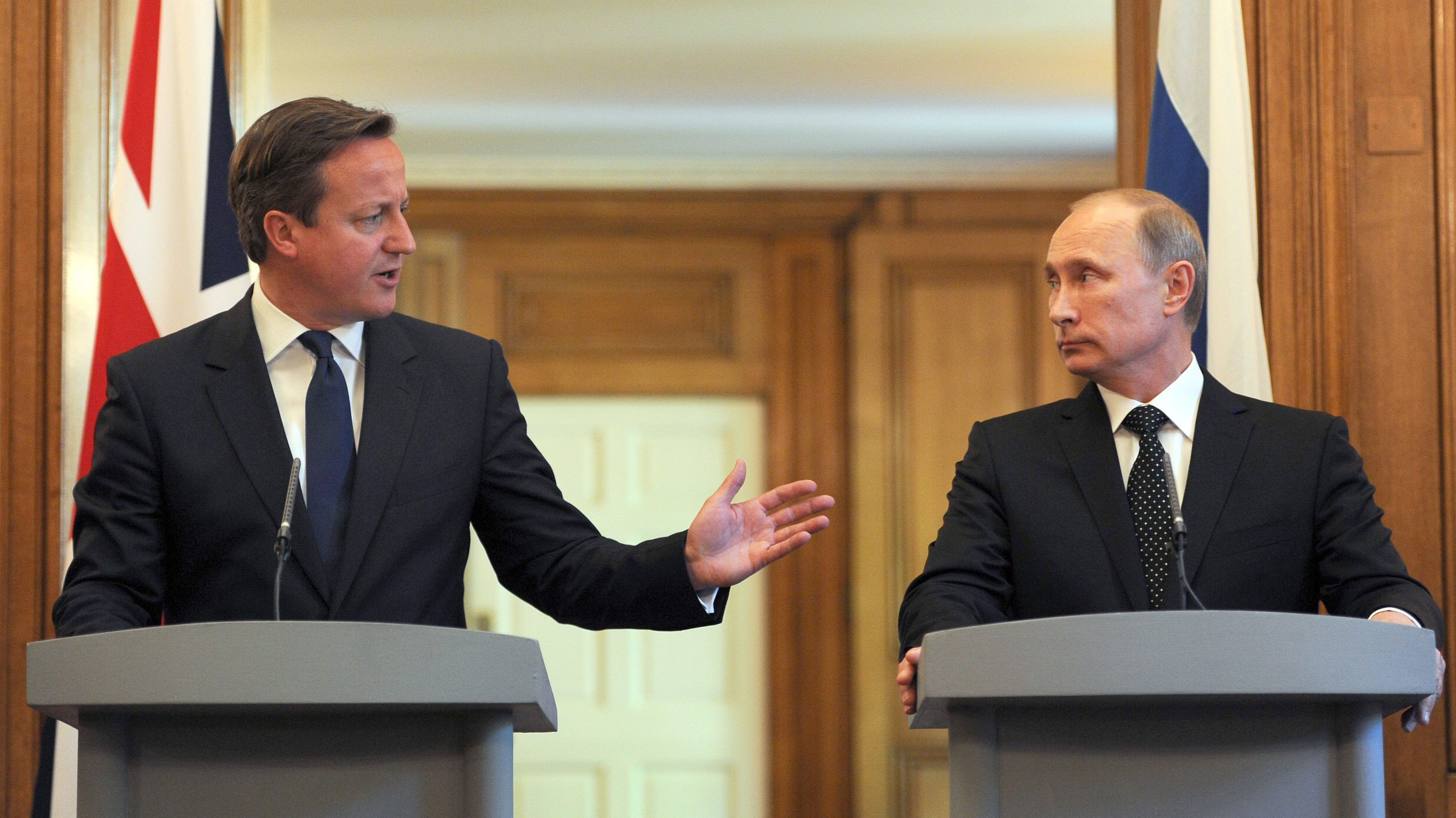 Britain's Prime Minister David Cameron and Russia's President Vladimir Putin hold a joint news conference in 10 Downing Street, central London
