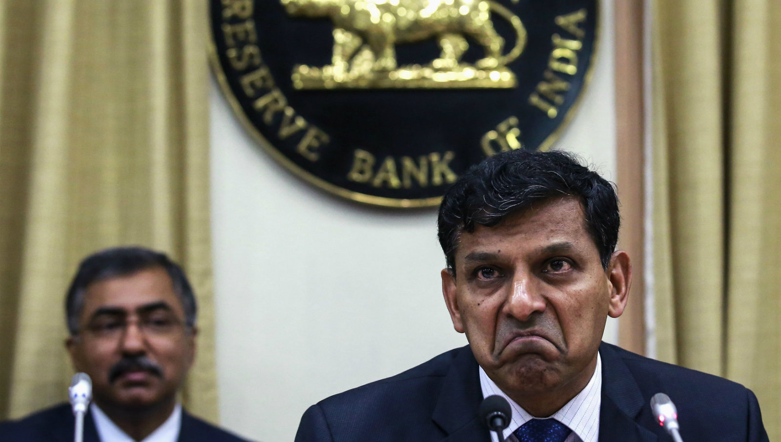 The Reserve Bank of India (RBI) Governor Raghuram Rajan gestures while replying to a question during a news conference after the bi-monthly monetary policy review in Mumbai December 2, 2014. The RBI held interest rates steady as widely expected at a policy review on Tuesday, and said it could ease monetary policy early next year provided inflationary pressures do not reappear and the government controls the fiscal deficit.
