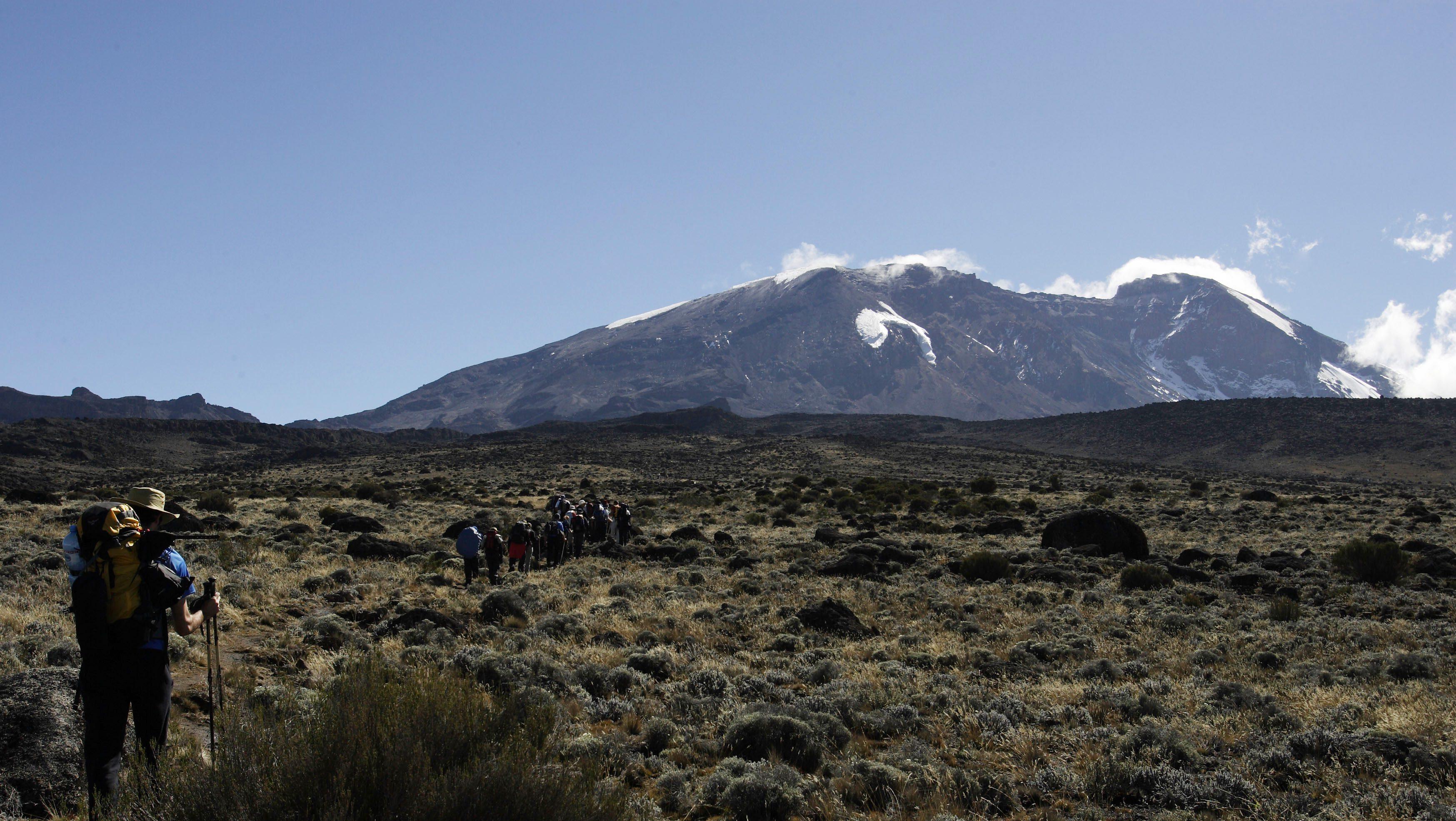 Trekkers cross the Shira Plateau on Tanzania's Mount Kilimanjaro