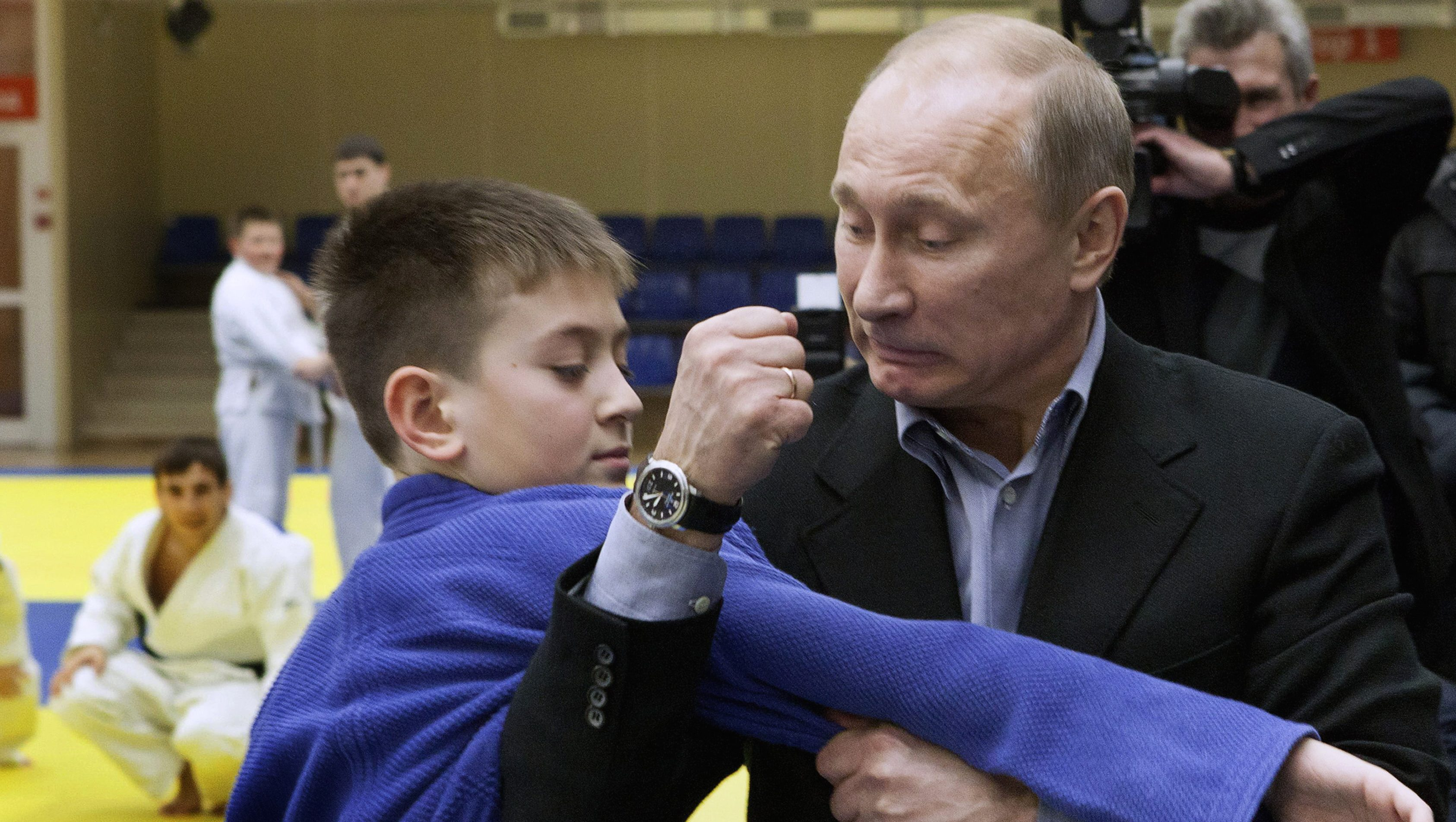 Russian Prime Minister Vladimir Putin instructs a trainee during a judo demonstration at a regional judo centre in the city of Kemerovo