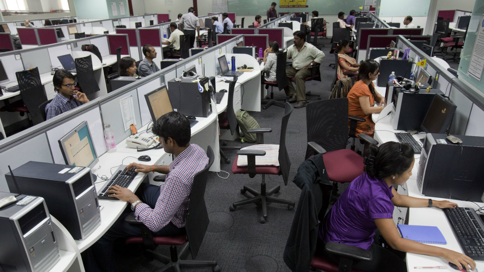 Workers are seen at their workstations on the floor of an outsourcing centre in Bangalore, February 29, 2012. India's IT industry, with Bangalore firms forming the largest component, is now worth an annual $100 billion and growing 14 percent per year, one of the few bright spots in an economy blighted by policy stagnation and political instability. Picture taken on February 29, 2012.