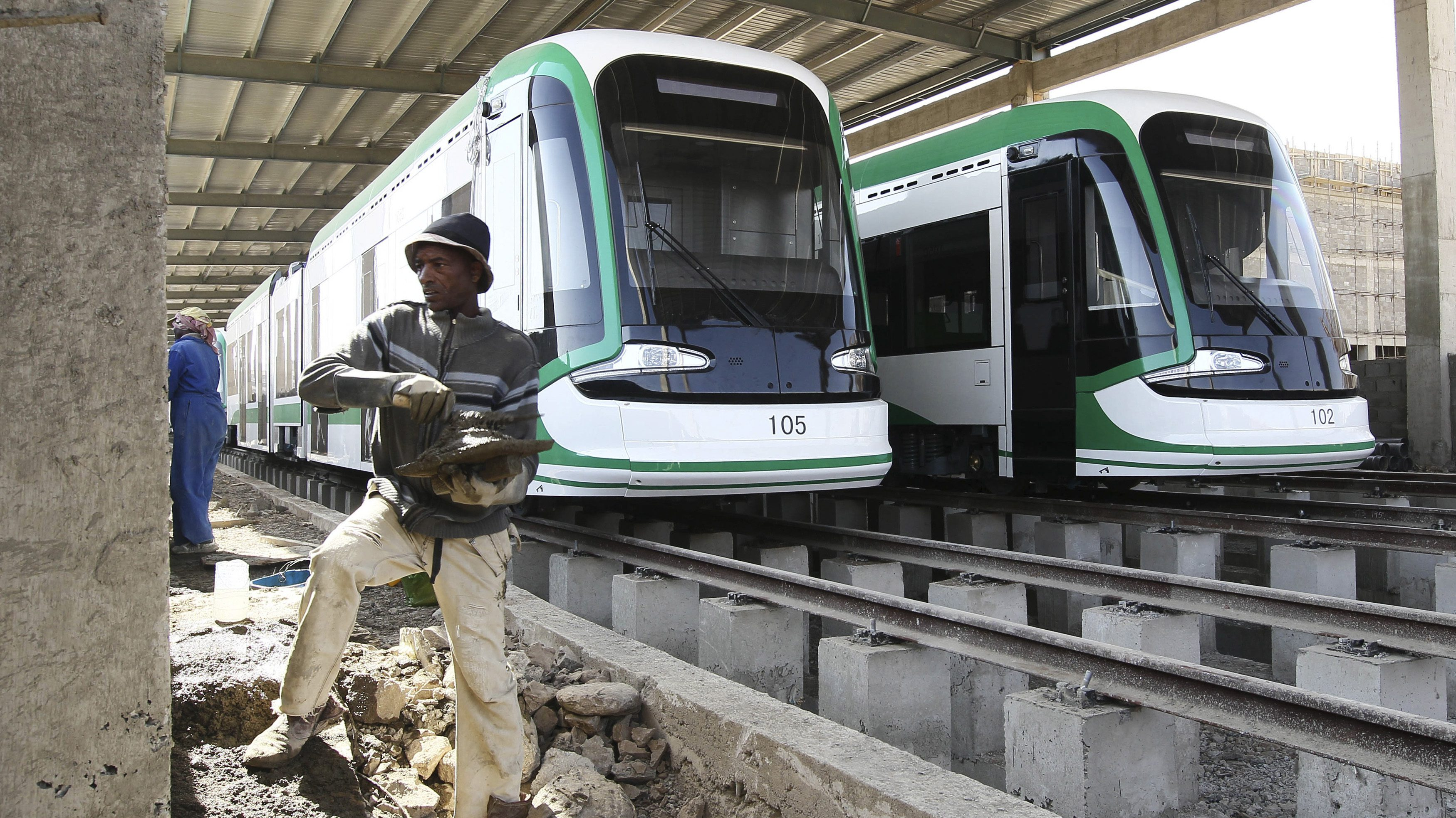 Worker works on the electrified light rail transit construction site in Ethiopia's capital Addis Ababa
