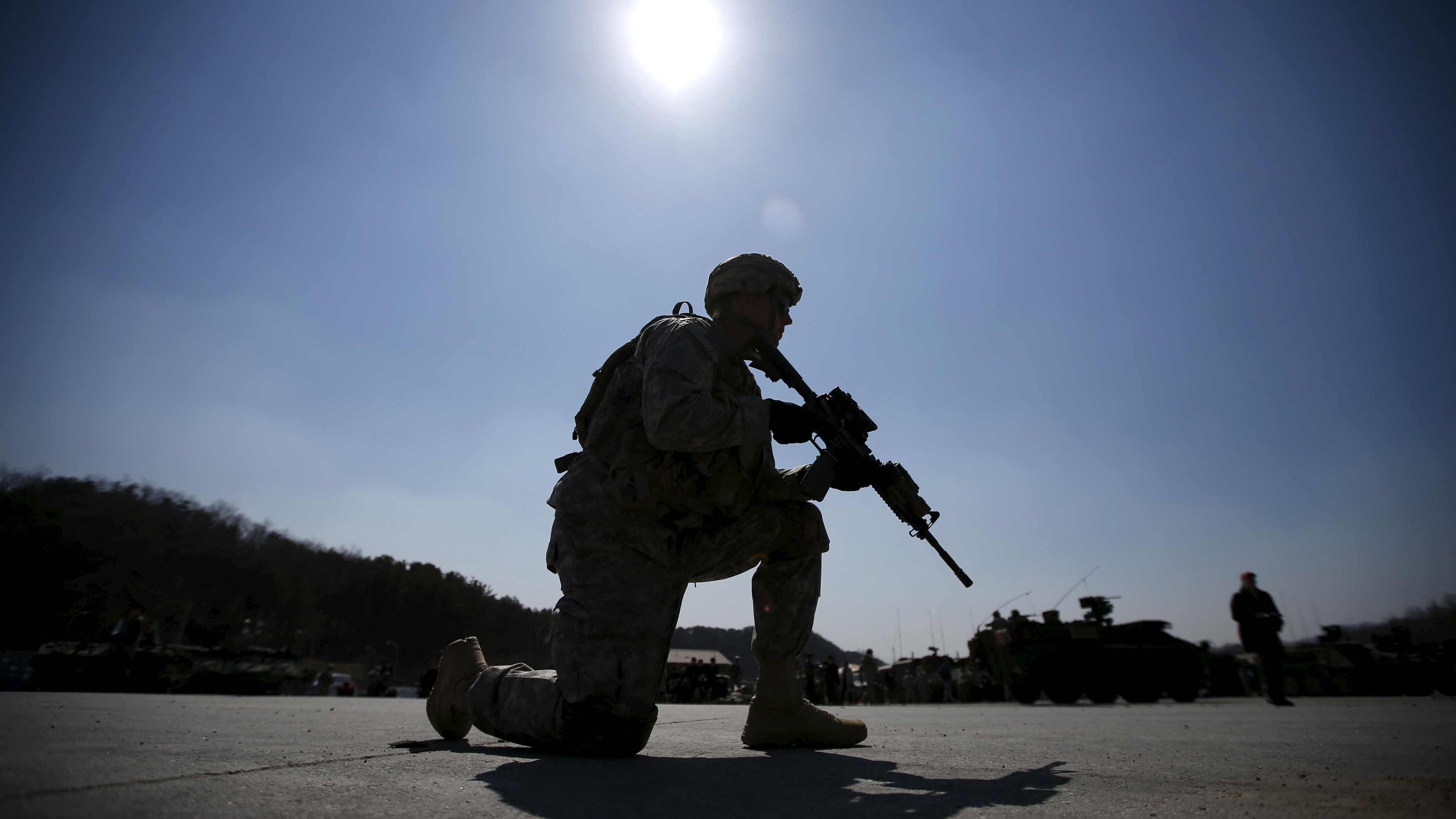 A U.S. Army soldier takes his position as he takes part in a U.S.-South Korea joint live-fire military exercise at a training field in Pocheon, south of the demilitarized zone separating the two Koreas, March 25, 2015. The exercise is part of Foal Eagle, an annual military training between U.S. and South Korea that runs from March 2 to April 24. REUTERS/Kim Hong-Ji