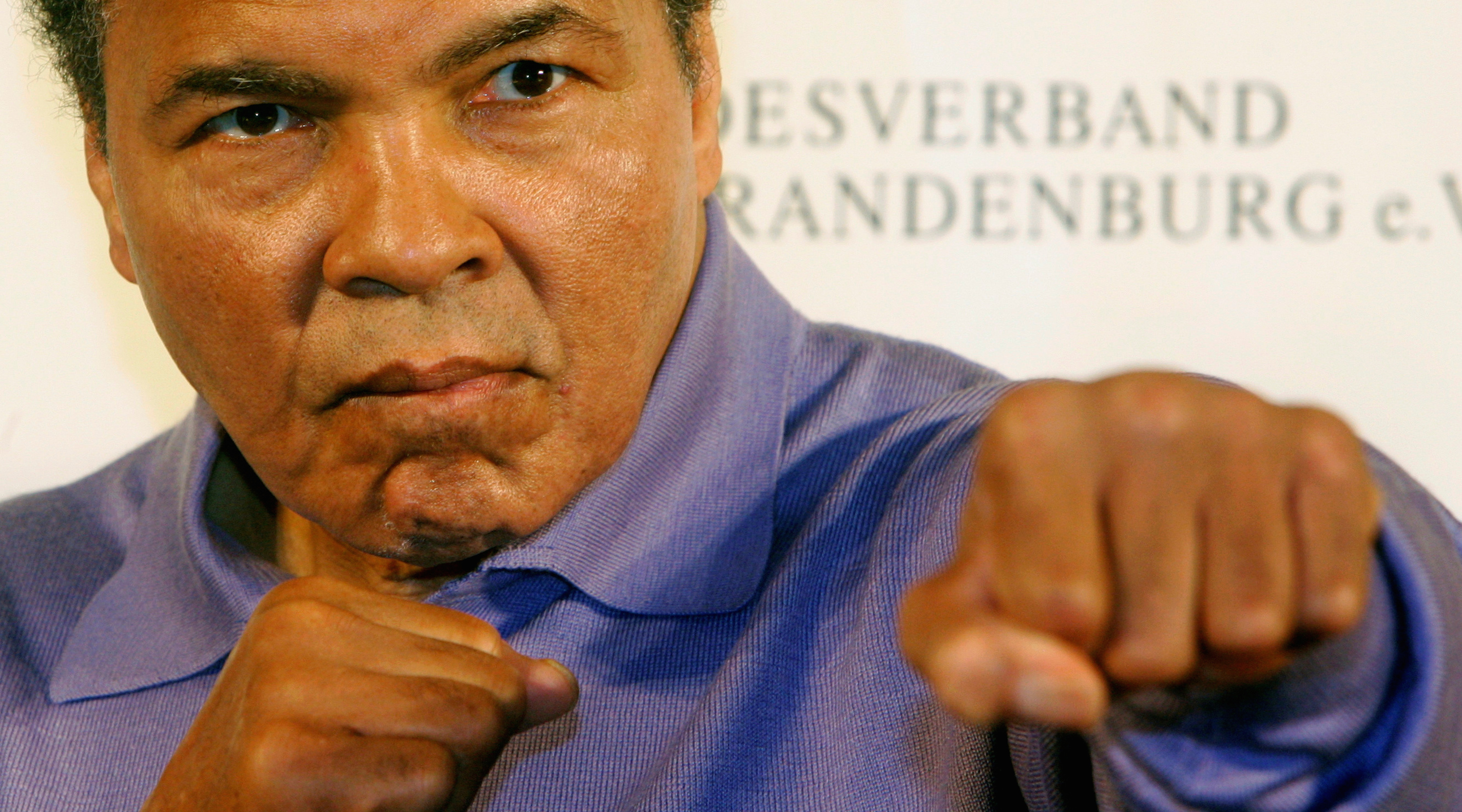 File photo of U.S. Boxing great Muhammad Ali posing for photographs during a news conference in Berlin