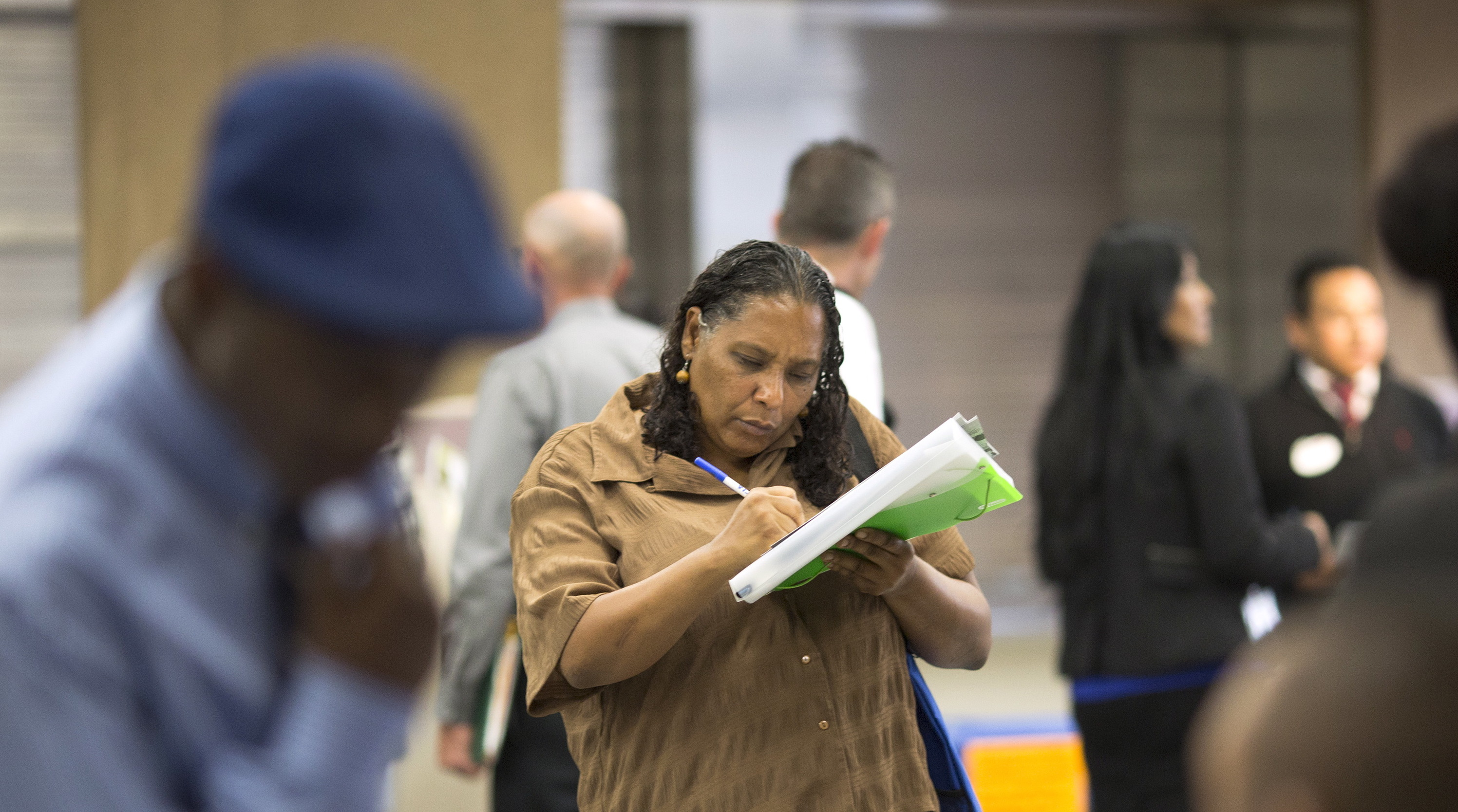 Malana Long fills out job application during job fair for homeless at Los Angeles Mission in Skid Row area of Los Angeles, California.