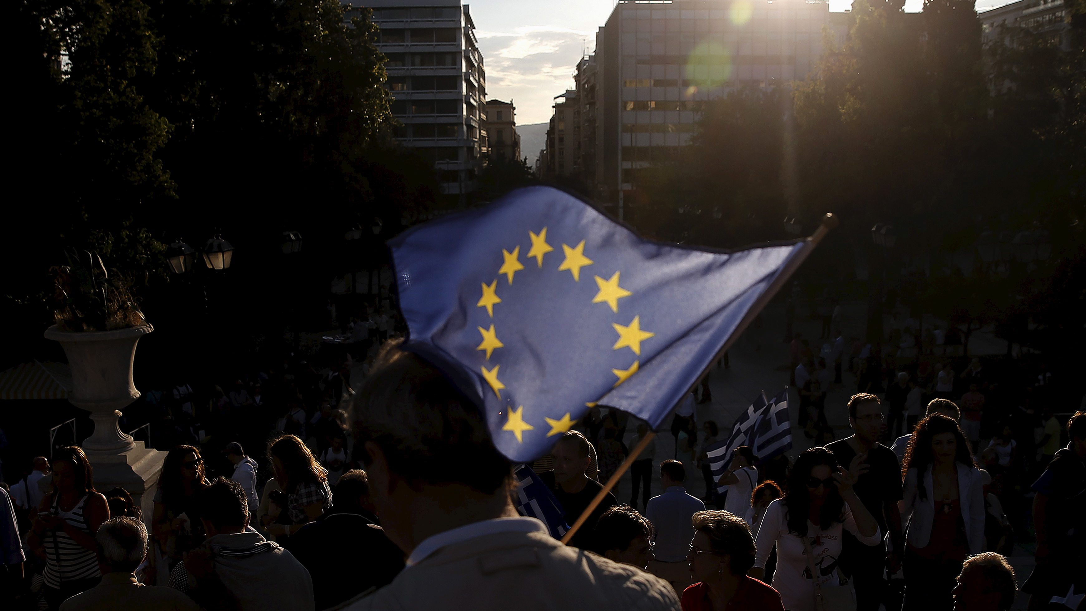 A pro-EU protester holds an European Union flag during a rally calling on the government to clinch a deal with its international creditors and secure Greece's future in the Eurozone, in Athens