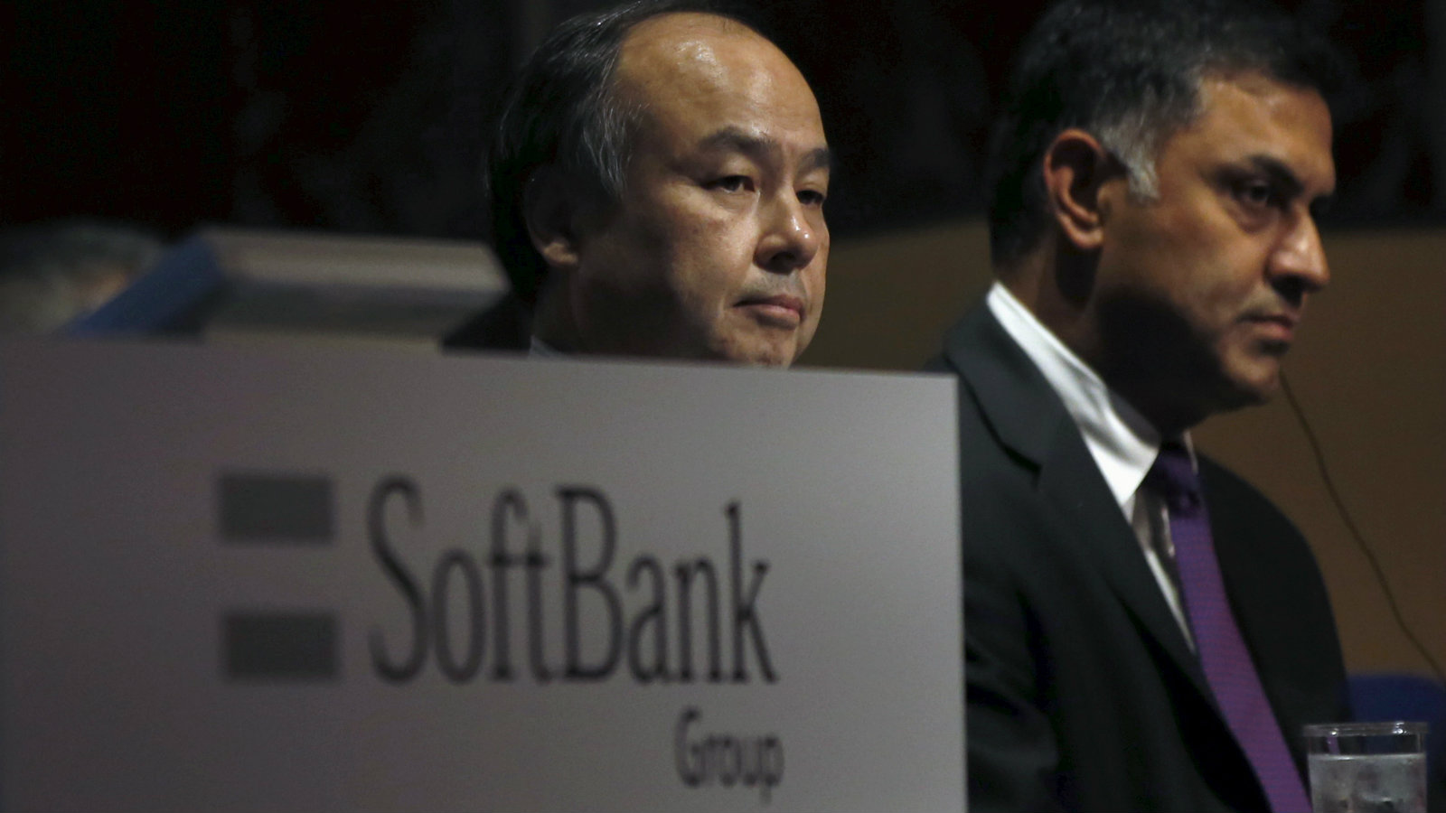 SoftBank Group Corp. Chairman and CEO Masayoshi Son (L) and President and COO Nikesh Arora attend a news conference in Tokyo, Japan, November 4, 2015. SoftBank Group's second-quarter operating profit rose 39 percent on cost cuts and some improvement at its struggling U.S. unit Sprint Corp.