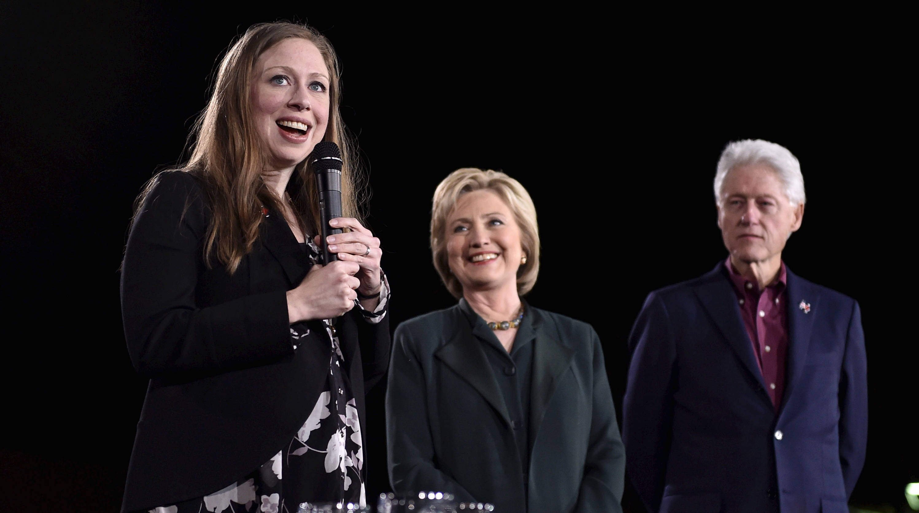 Chelsea Clinton speaks as U.S. Democratic presidential candidate Hillary Clinton and former President Bill Clinton look on at a campaign rally at the Clark County Government Center in Las Vegas