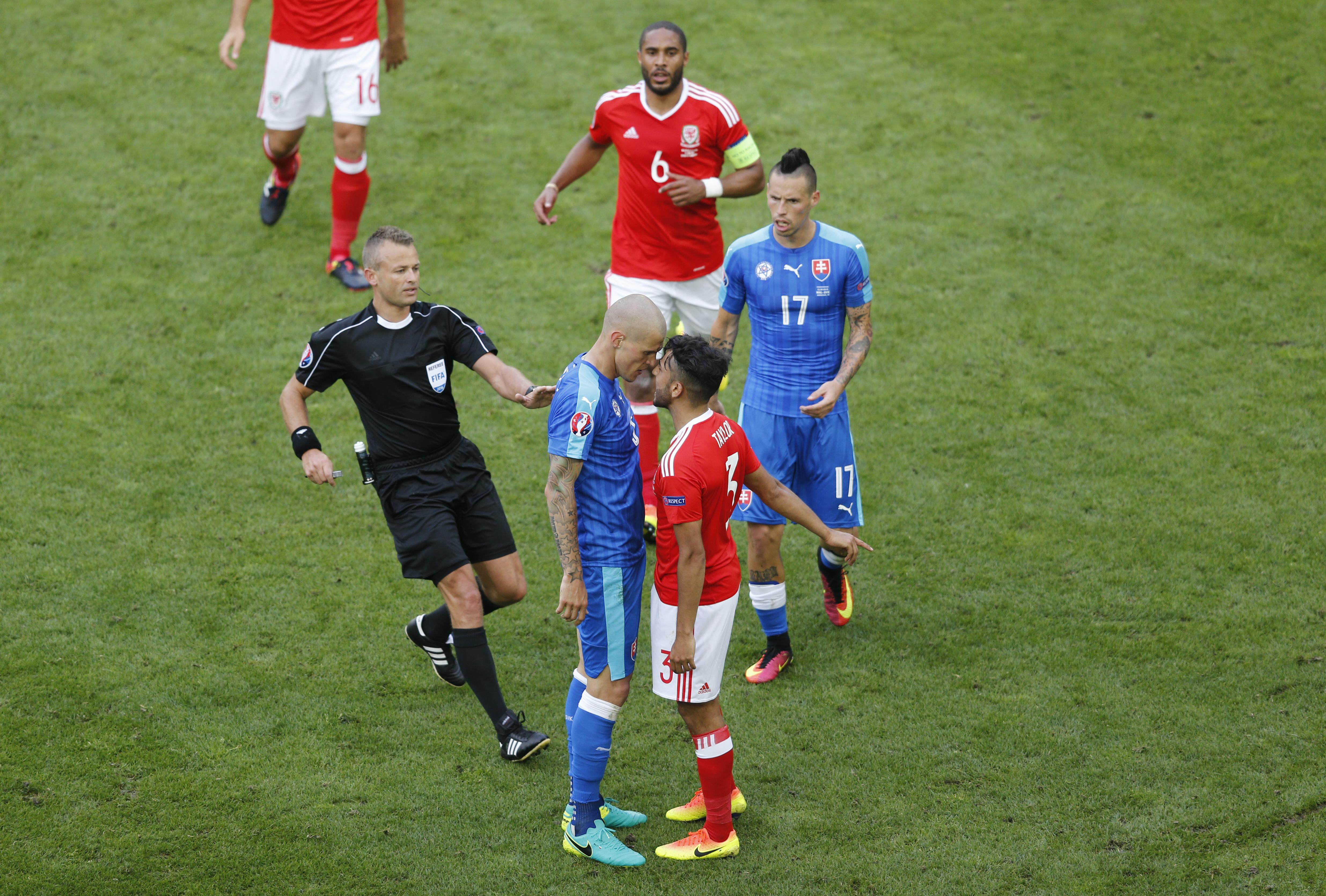 Slovakia's Martin Skrtel clashes with Wales' Neil Taylor. (Reuters/Regis Duvignau)