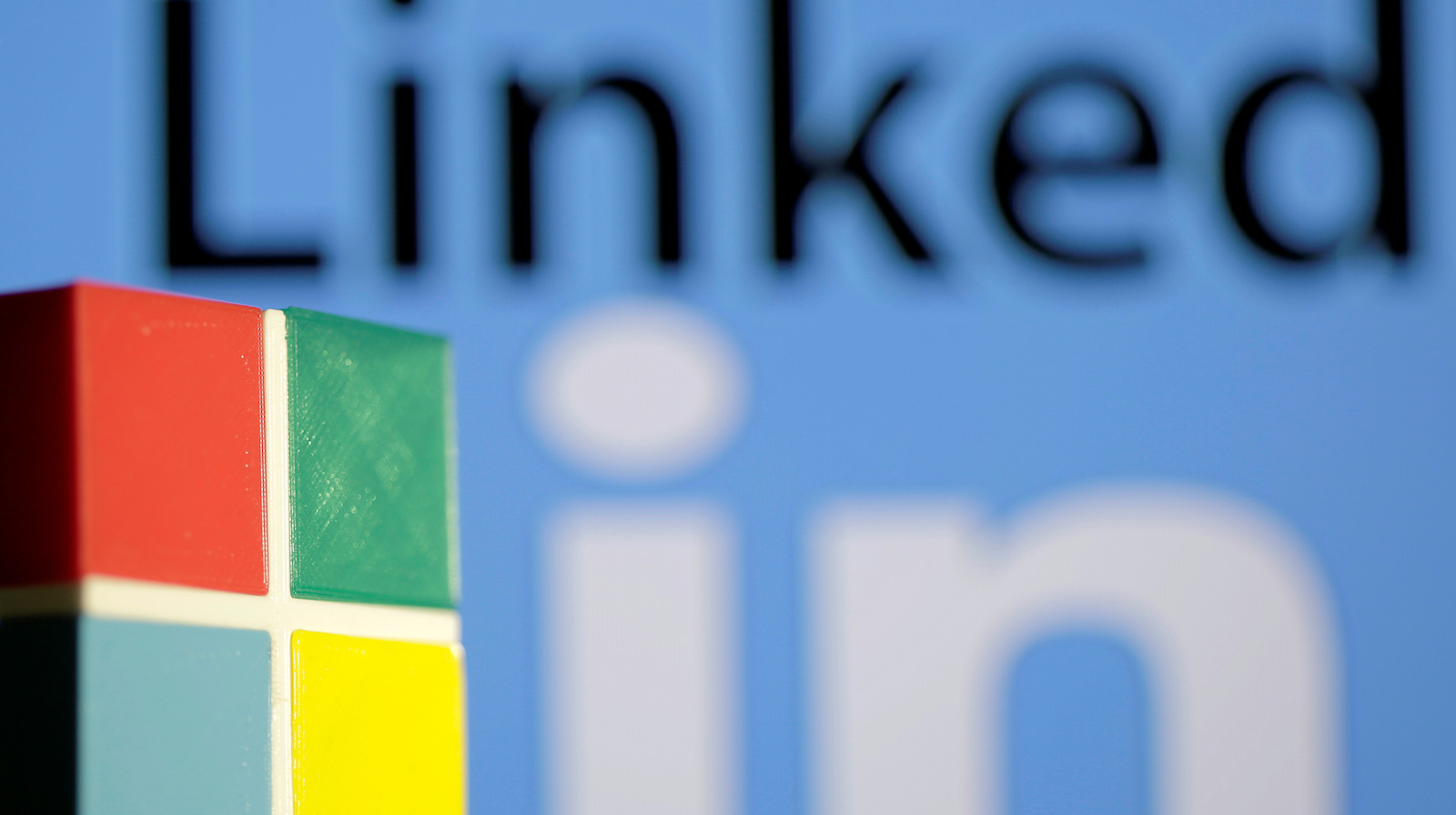 A 3D printed logo of Microsoft is seen in front of a displayed LinkedIn logo in this illustration taken, June 13, 2016. REUTERS/Dado Ruvic/Illustration - RTX2FZB4