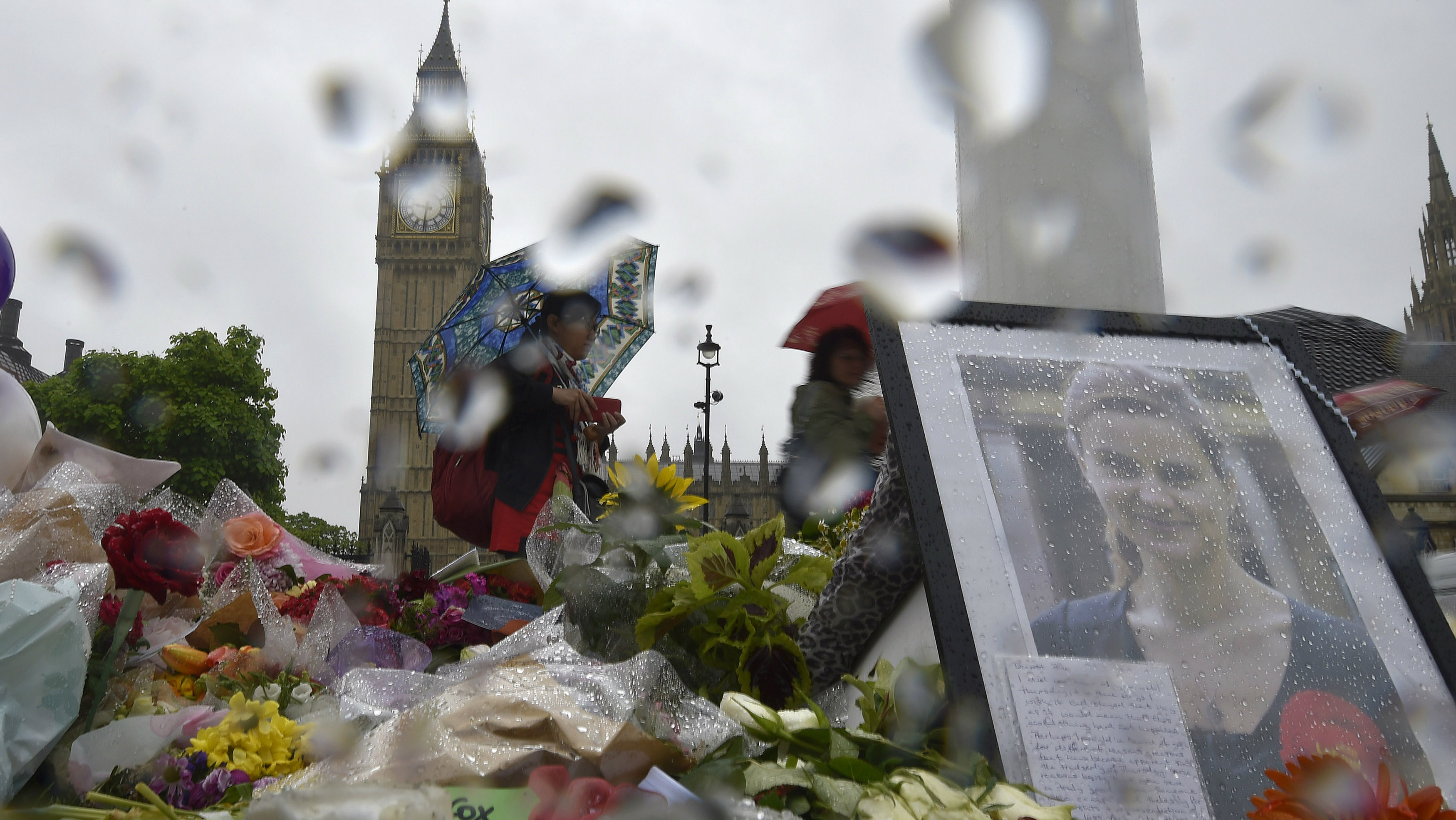 Tributes laid in memory of murdered MP Jo Cox at Parliament Square, London.