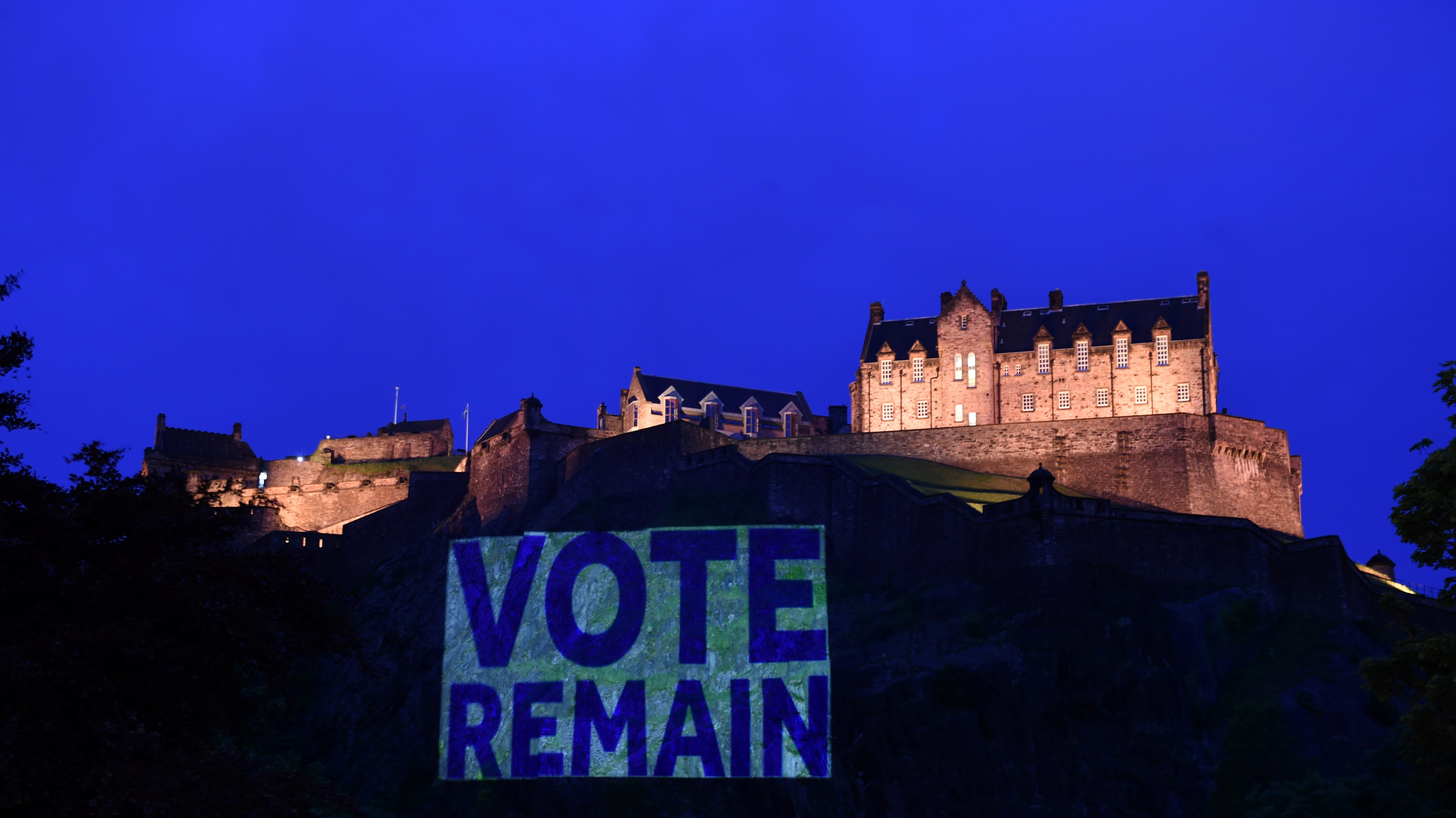 "Edinburgh Castle rock is illuminated with a sign to ""Vote Remain"" in a show of support for the campaign to remain in Europe ahead of Thursday's EU Referendum in Scotland"