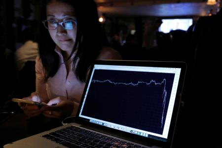 A woman watching the Brexit vote in The Churchill Tavern, a British themed pub, reacts as a graph shows the British Pound falling in value following the announcement that Britain would leave the European Union, in the Manhattan, New York on June 23. (Reuters/Andrew Kelly)