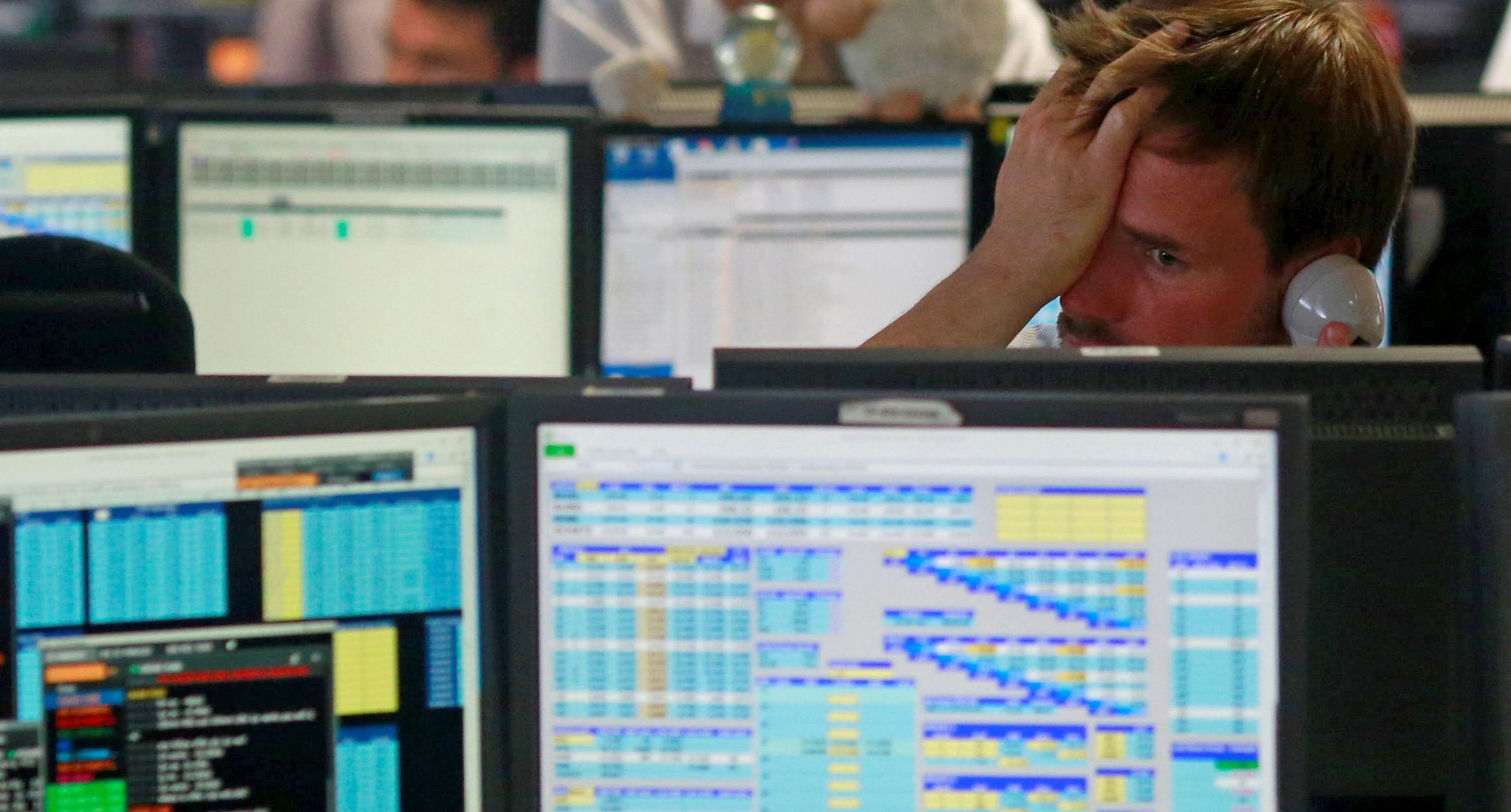 A trader from BGC, a global brokerage in London, reacts to the opening of European markets.