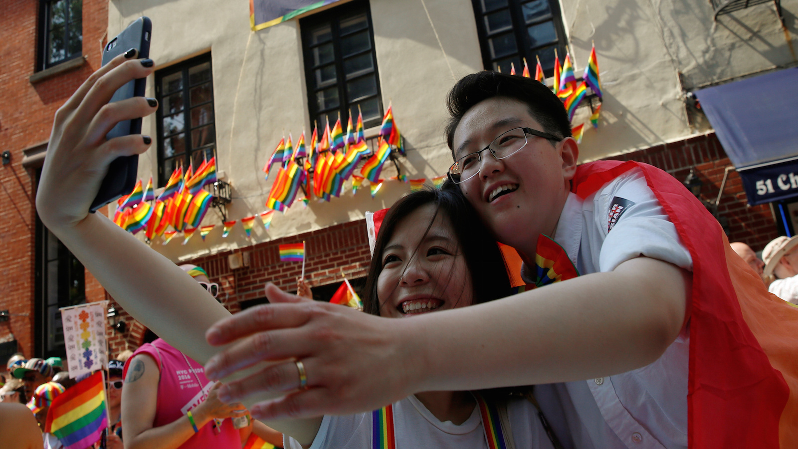 Participants pose for a selfie in front of the Stonewall Inn during the annual NYC Pride parade in New York City, New York, U.S., June 26, 2016.