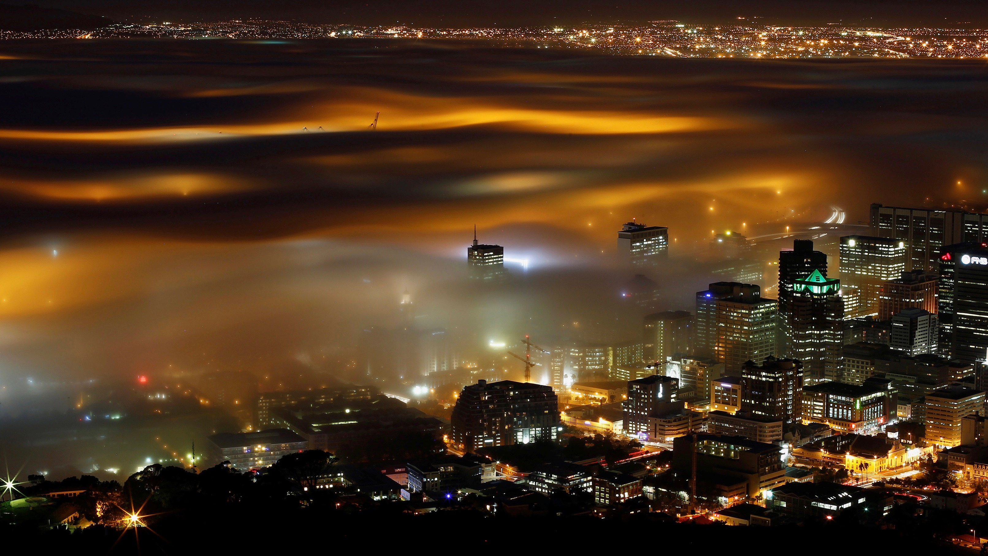 Seasonal fog is illuminated by the lights of Cape Town harbour as the city prepares for the start of the southern hemisphere winter, May 8, 2012.