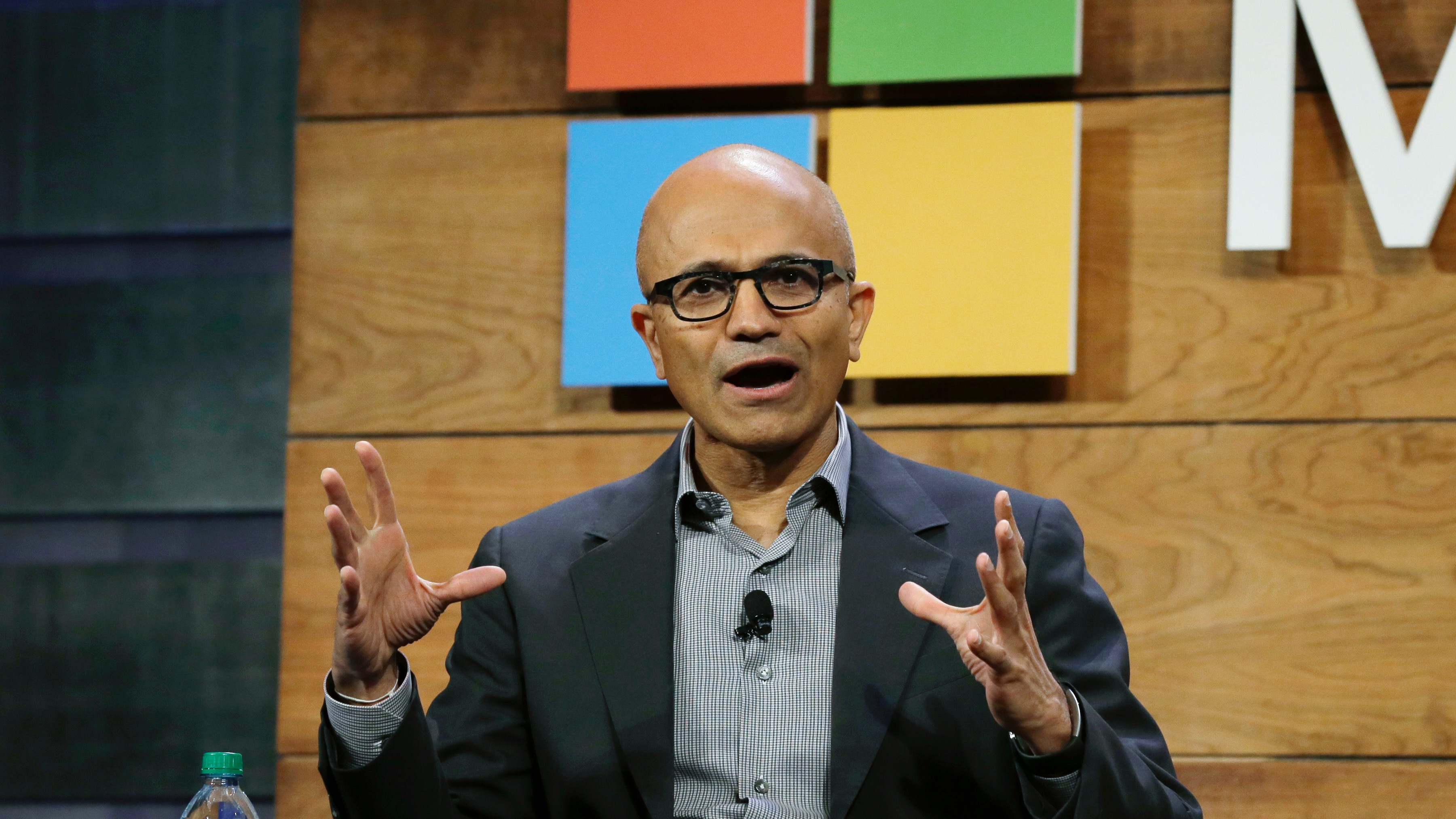 Microsoft Corp. CEO Satya Nadella speaks Wednesday, Dec. 2, 2015, at Microsoft's annual shareholders meeting in Bellevue, Wash. (AP Photo/Ted S. Warren)