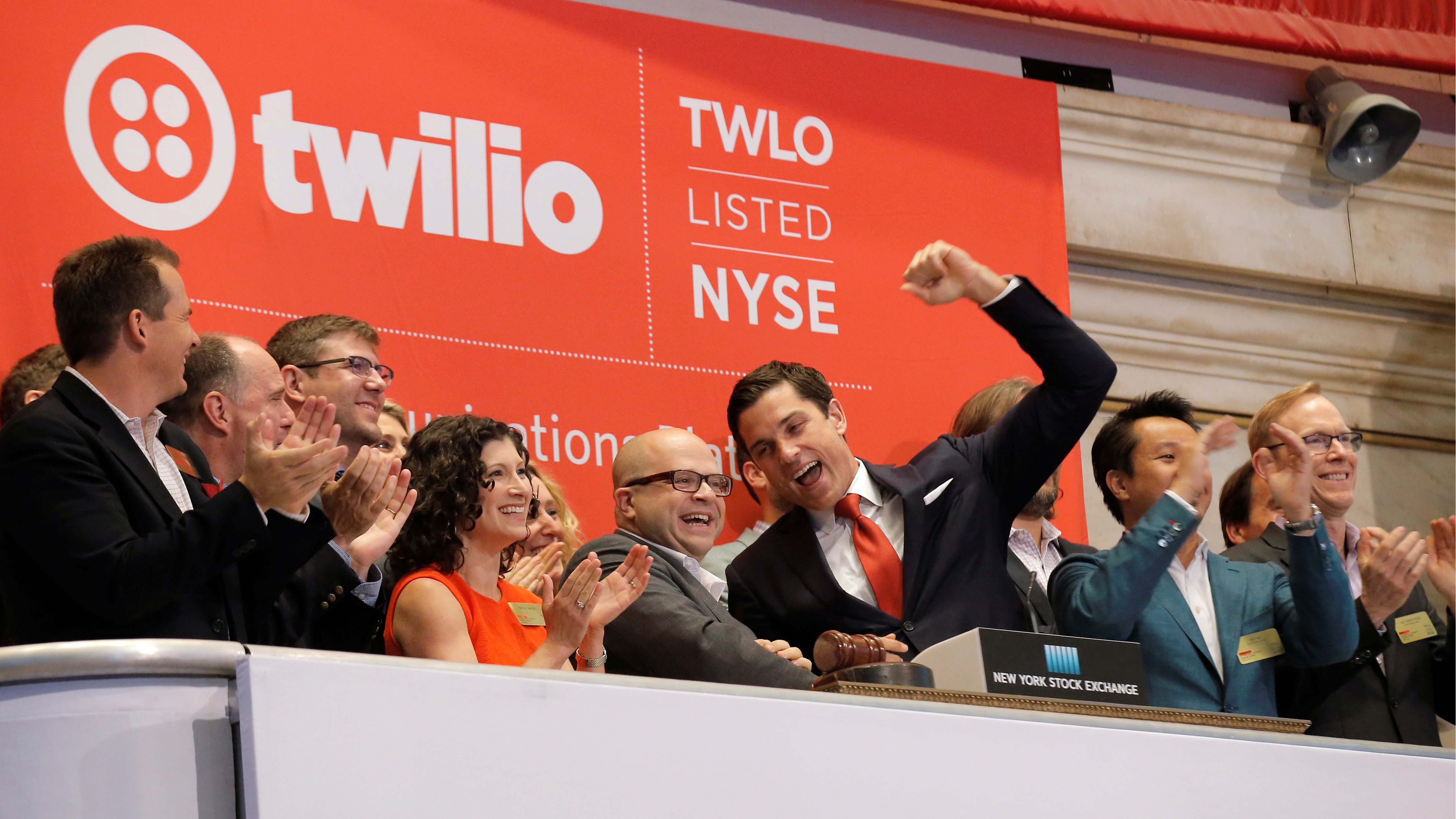 Jeff Lawson, (C) Founder, CEO, & Chairman of Communications software provider Twilio Inc., rings the opening bell to celebrate his company's IPO at the New York Stock Exchange (NYSE) in New York City, U.S., June 23, 2016. REUTERS/Brendan McDermid TPX IMAGES OF THE DAY - RTX2HTCR