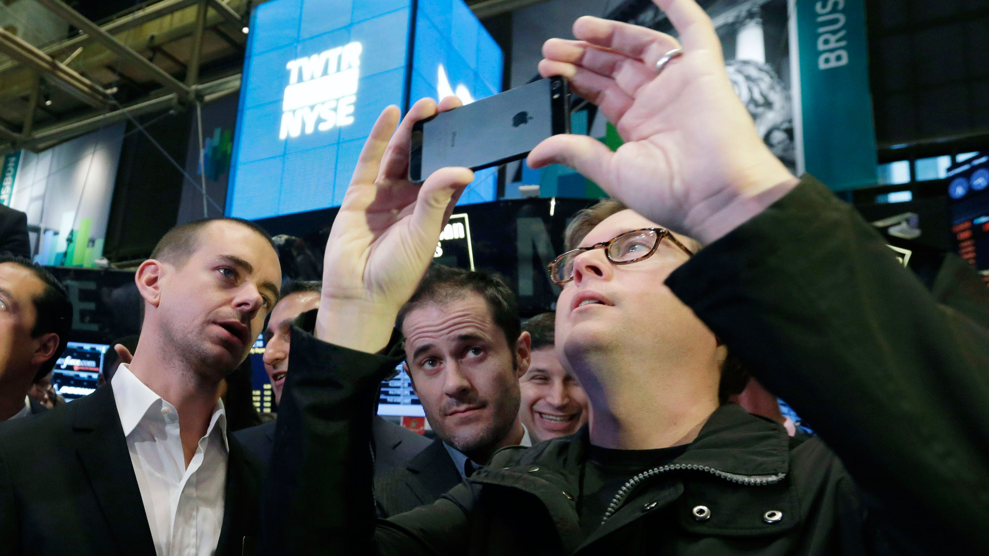 Twitter Chairman and co-founder Jack Dorsey, and co-founders Evan Williams and Biz Stone, wait for the opening bell to be rung at the New York Stock Exchange, Thursday, Nov. 7, 2013. If Twitter's bankers and executives were hoping for a surge on the day of the stock's public debut, they got it. The stock opened at $45.10 a share on its first day of trading, 73 percent above its initial offering price. (AP Photo/Richard Drew)