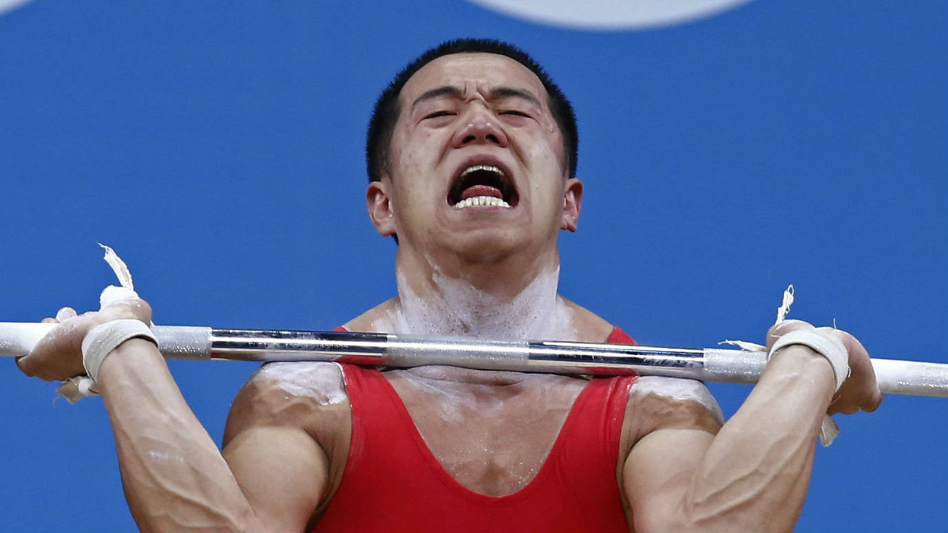North Korea's Yun Chol Om competes on the 56Kg Group B weightlifting competition at the London 2012 Olympic Games July 29, 2012. REUTERS/Dominic Ebenbichler (BRITAIN - Tags: SPORT OLYMPICS SPORT WEIGHTLIFTING)