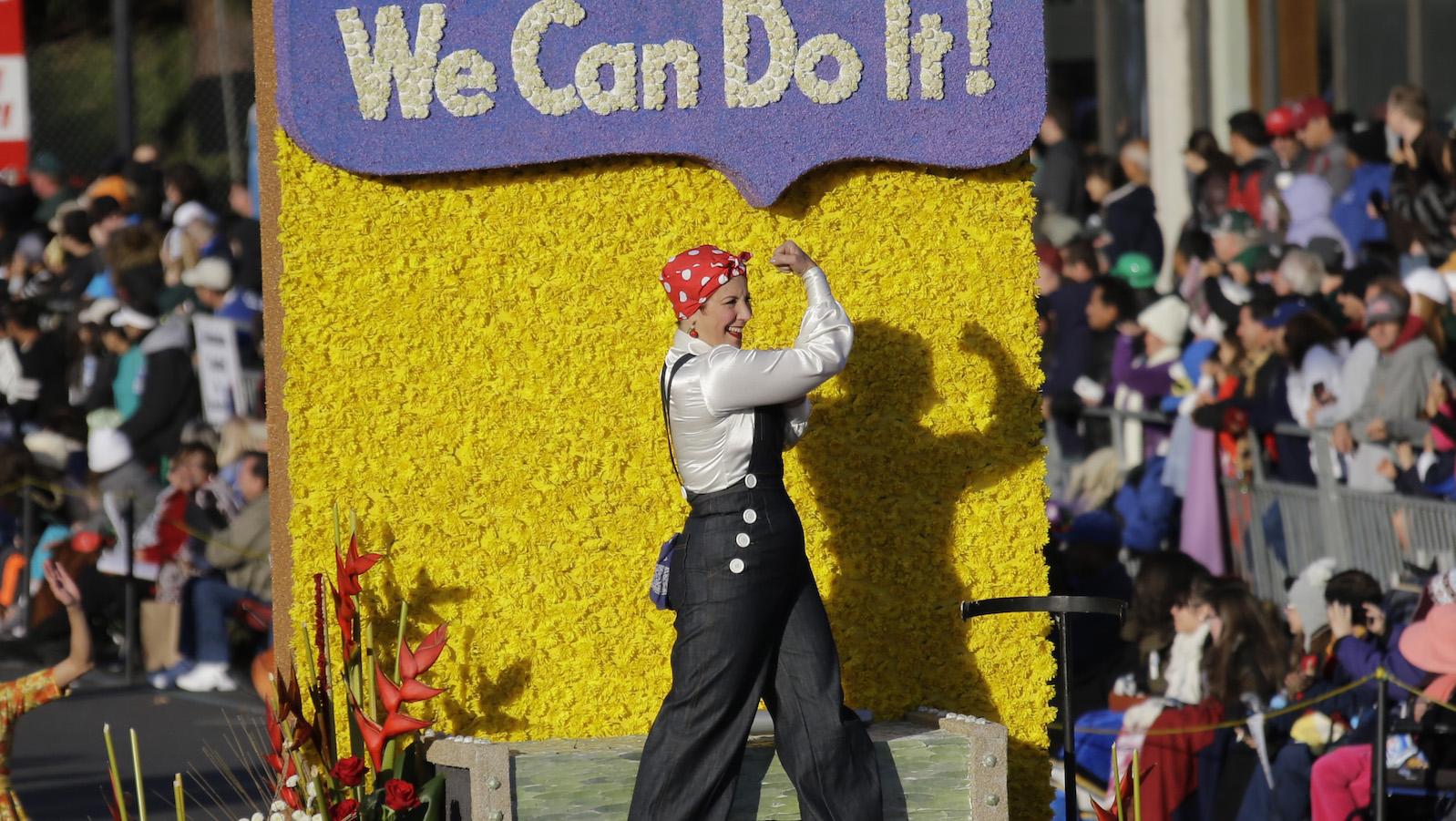 A Rosie The Riveter figure is seen aboard the Wells Fargo float in the 125th Rose Parade in Pasadena, Calif., Wednesday, Jan. 1, 2014. (AP Photo/Reed Saxon)
