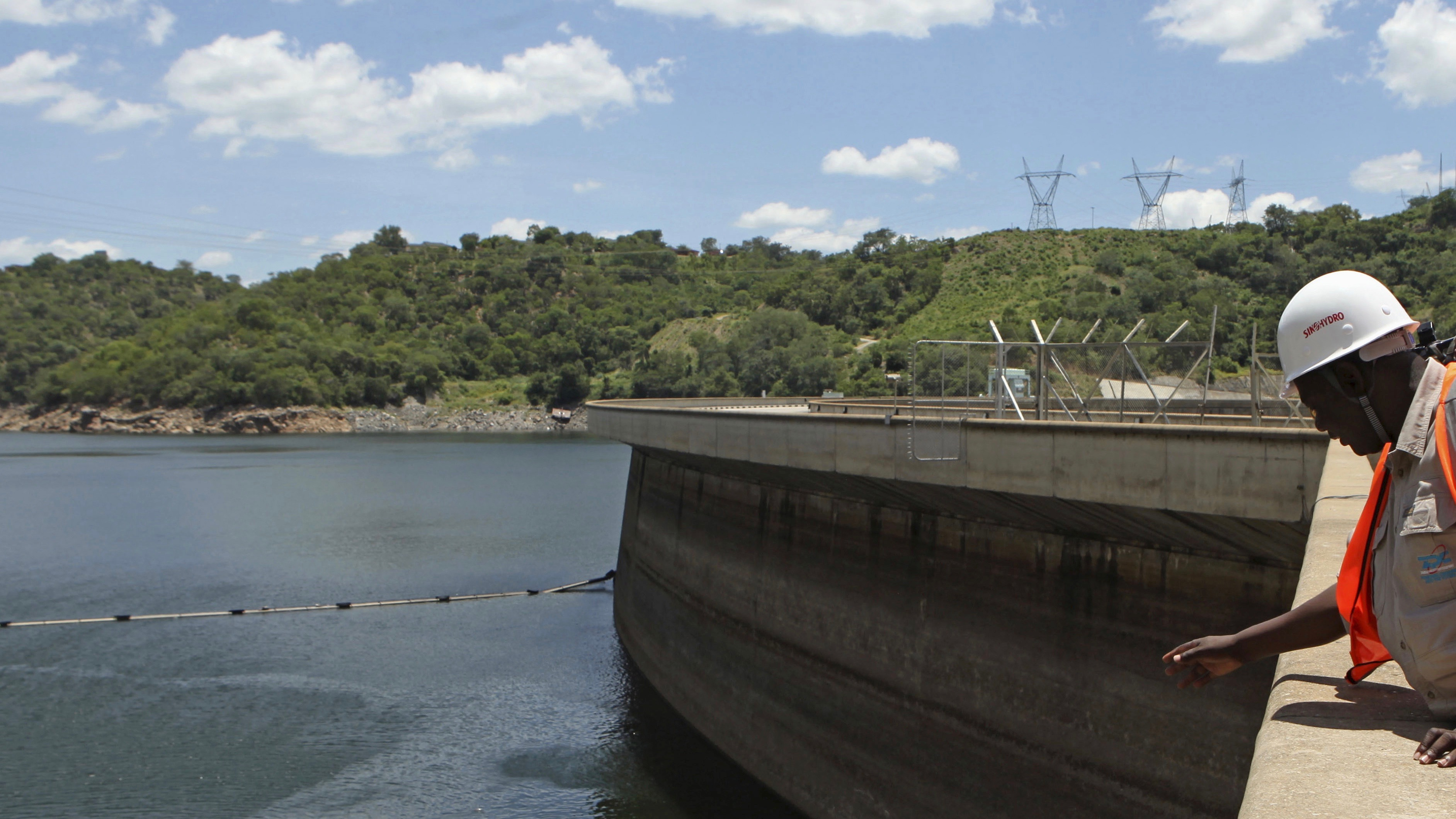 An official of the Zimbabwe Electricity Supply Authourity (ZESA) inspects water levels on the Kariba dam in Kariba, Zimbabwe, February 19, 2016.