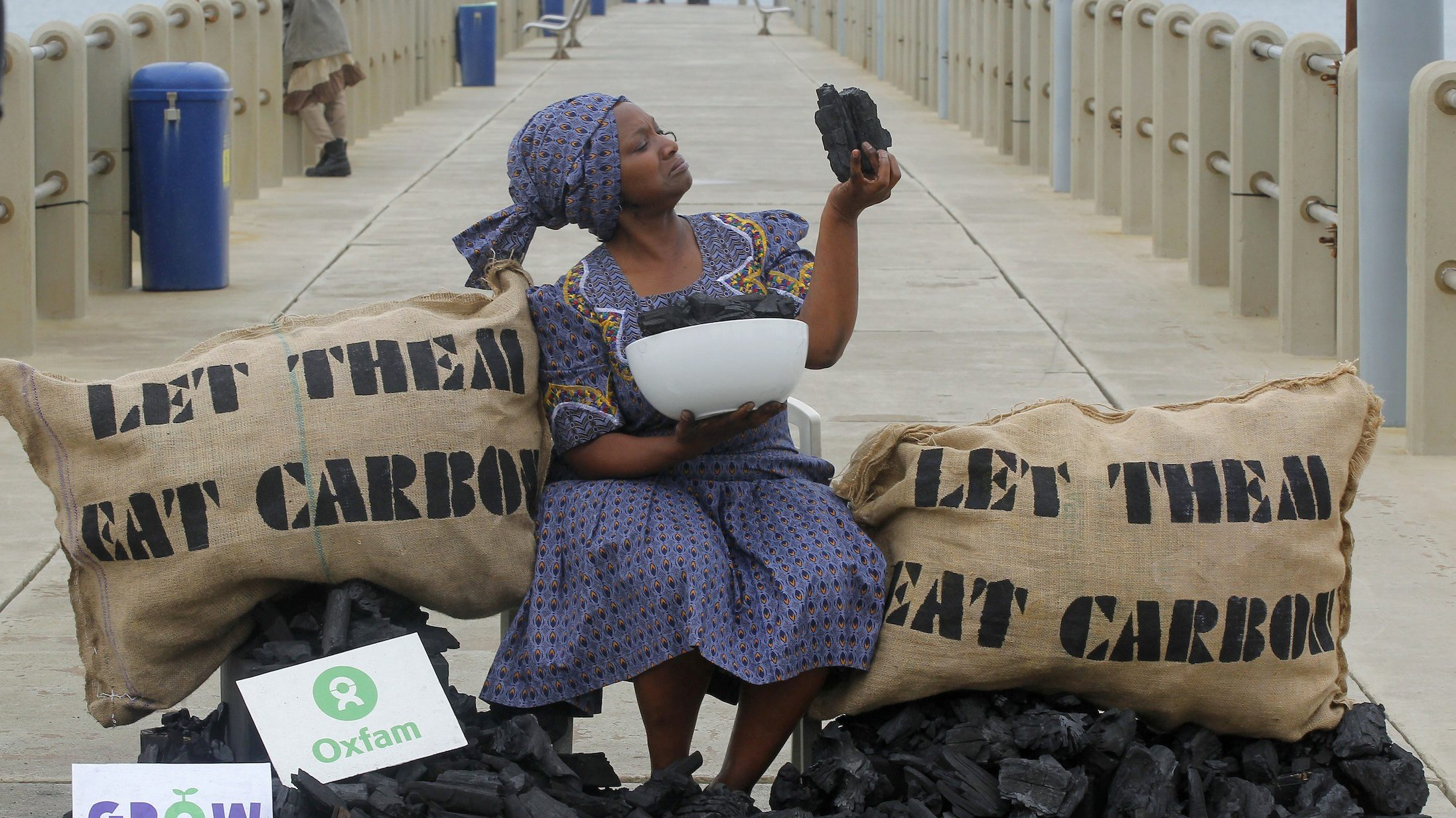 Busi Ndlovu, a member of the aid group OXFAM, stages a protest against the use of coal-based energy on Durban's beachfront