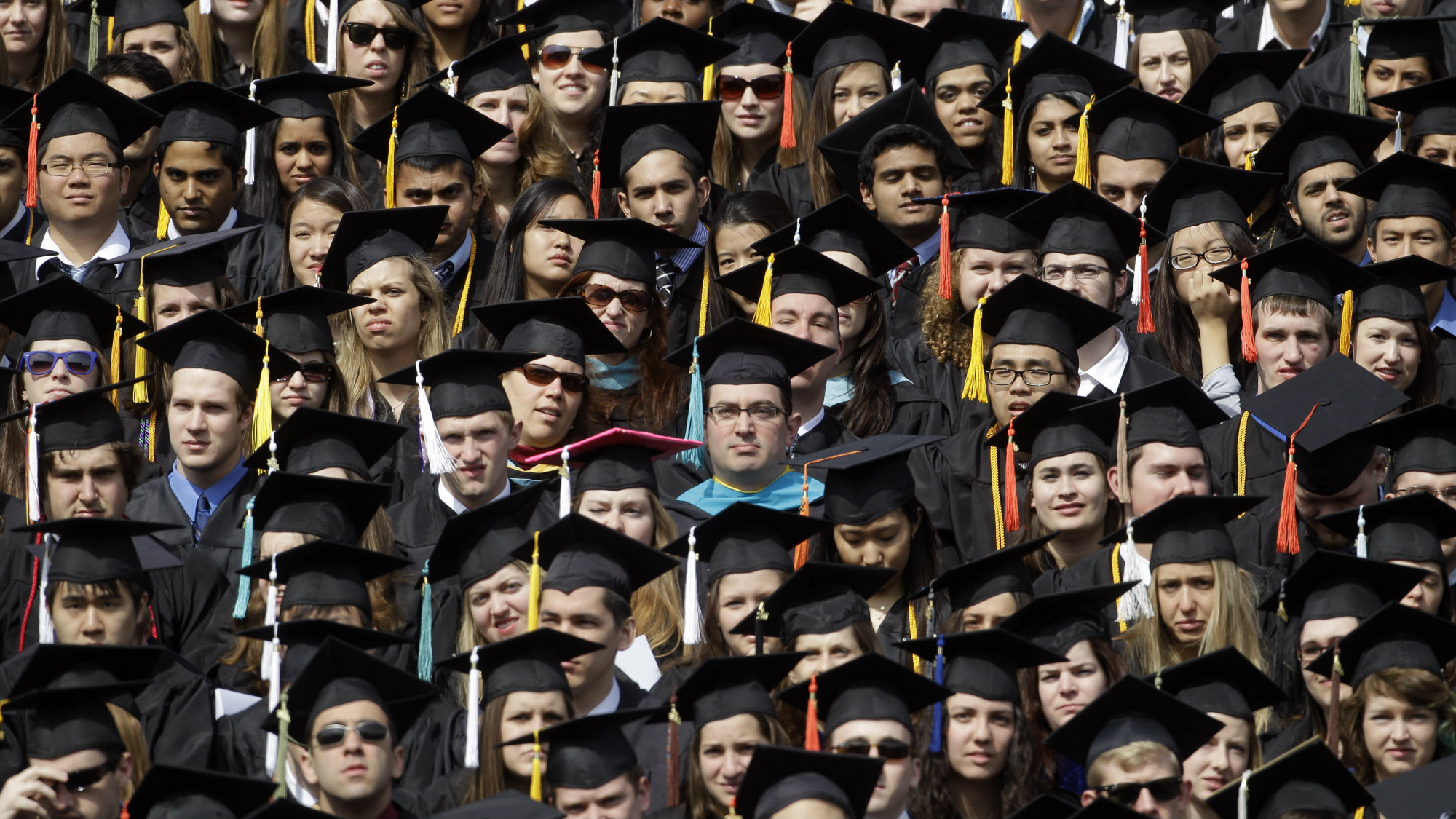 Graduates listen as Michigan Gov. Rick Snyder delivers his address at the University of Michigan commencement ceremony at Michigan Stadium.